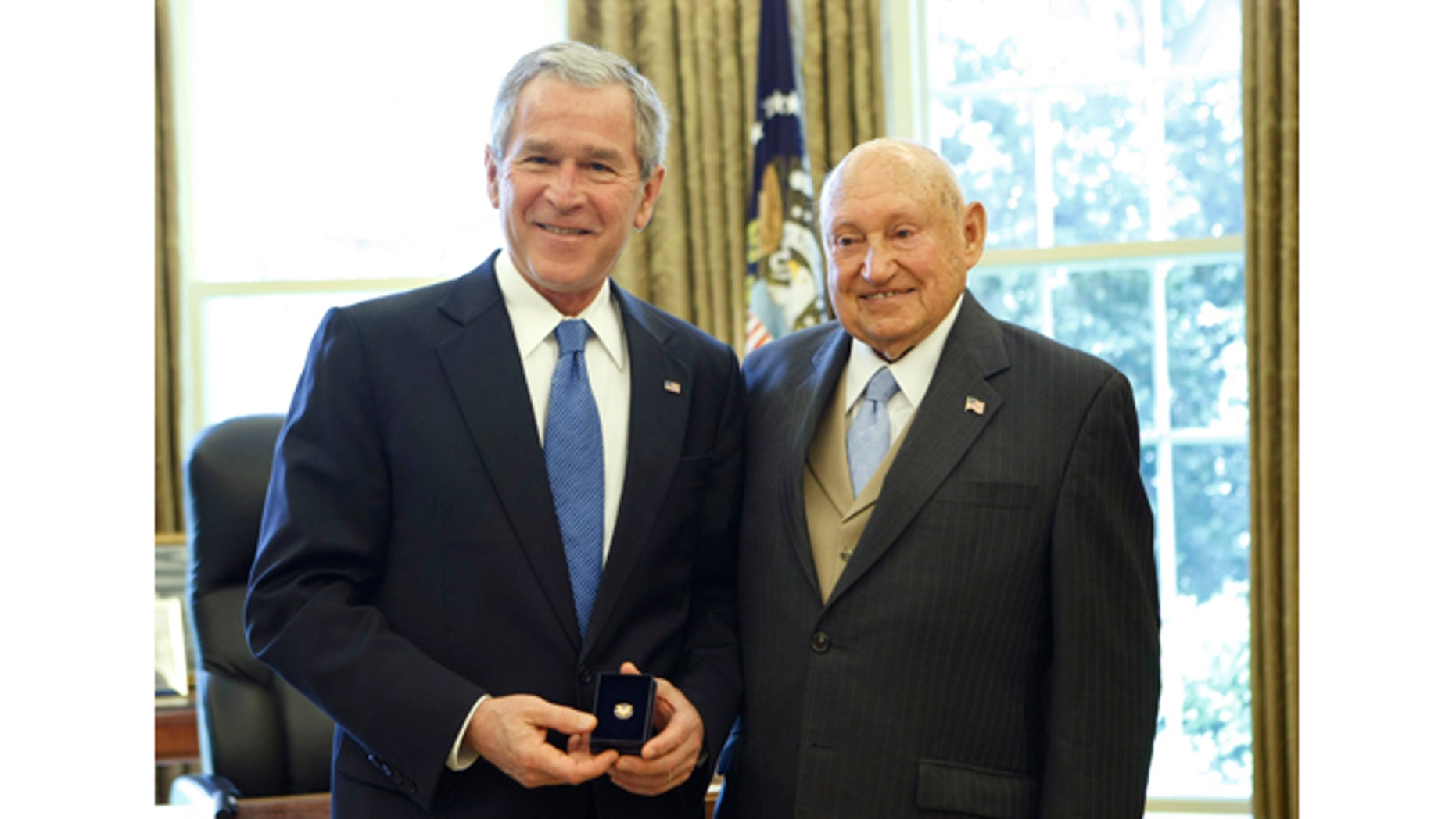 FILE - In this April 15, 2008, file photo, then President George W. Bush presents the Lifetime President's Volunteer Service Award to Chick fil-A Inc. founder S. Truett Cathy in the Oval Office of the White House in Washington. (AP Photo/Gerald Herbert, File)