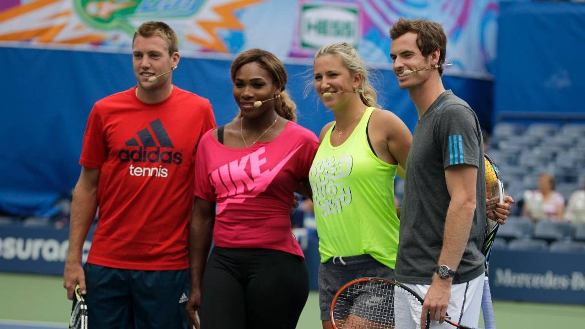 Tennis players, from left, Jack Sock, Serena Williams, Victoria Azarenka and Andy Murray appear at U.S. Open Arthur Ashe Kids Day at the USTA Billie Jean King National Tennis Center on Saturday, Aug. 23, 2014, in New York. (Photo by Andy Kropa/Invision/AP)