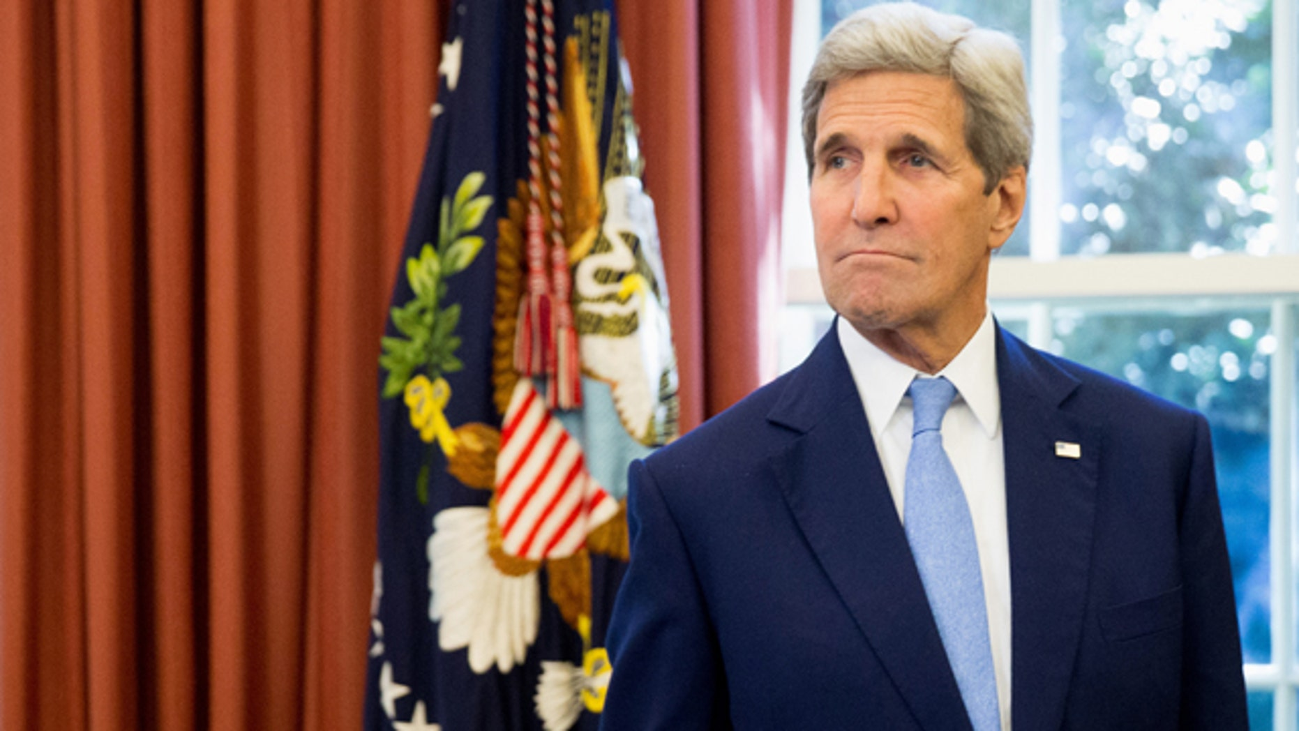 FILE - In this Sept. 15, 2015 file photo, Secretary of State John Kerry is seen in the Oval Office of the White House in Washington. (AP Photo/Andrew Harnik, File)