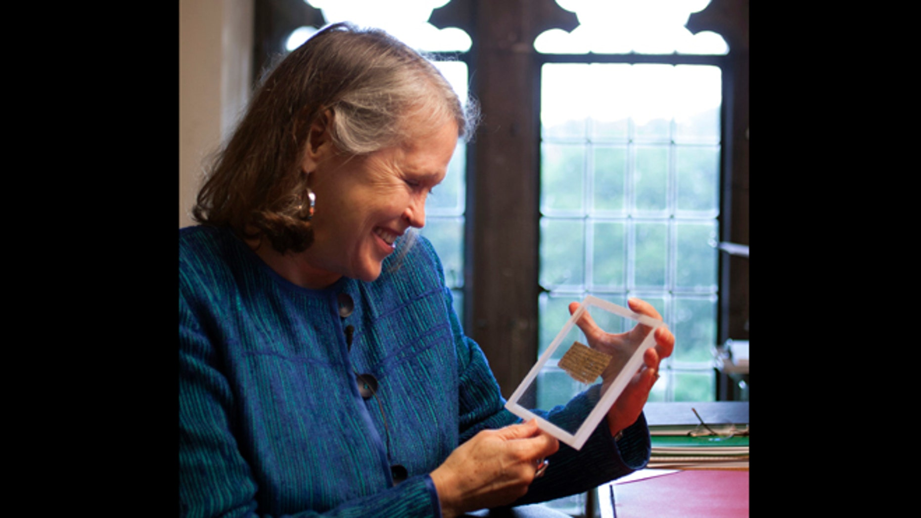 Sept. 5, 2012: Divinity professor Karen L. King holds a fourth century fragment of papyrus that she says is the only existing ancient text that quotes Jesus explicitly referring to having a wife.