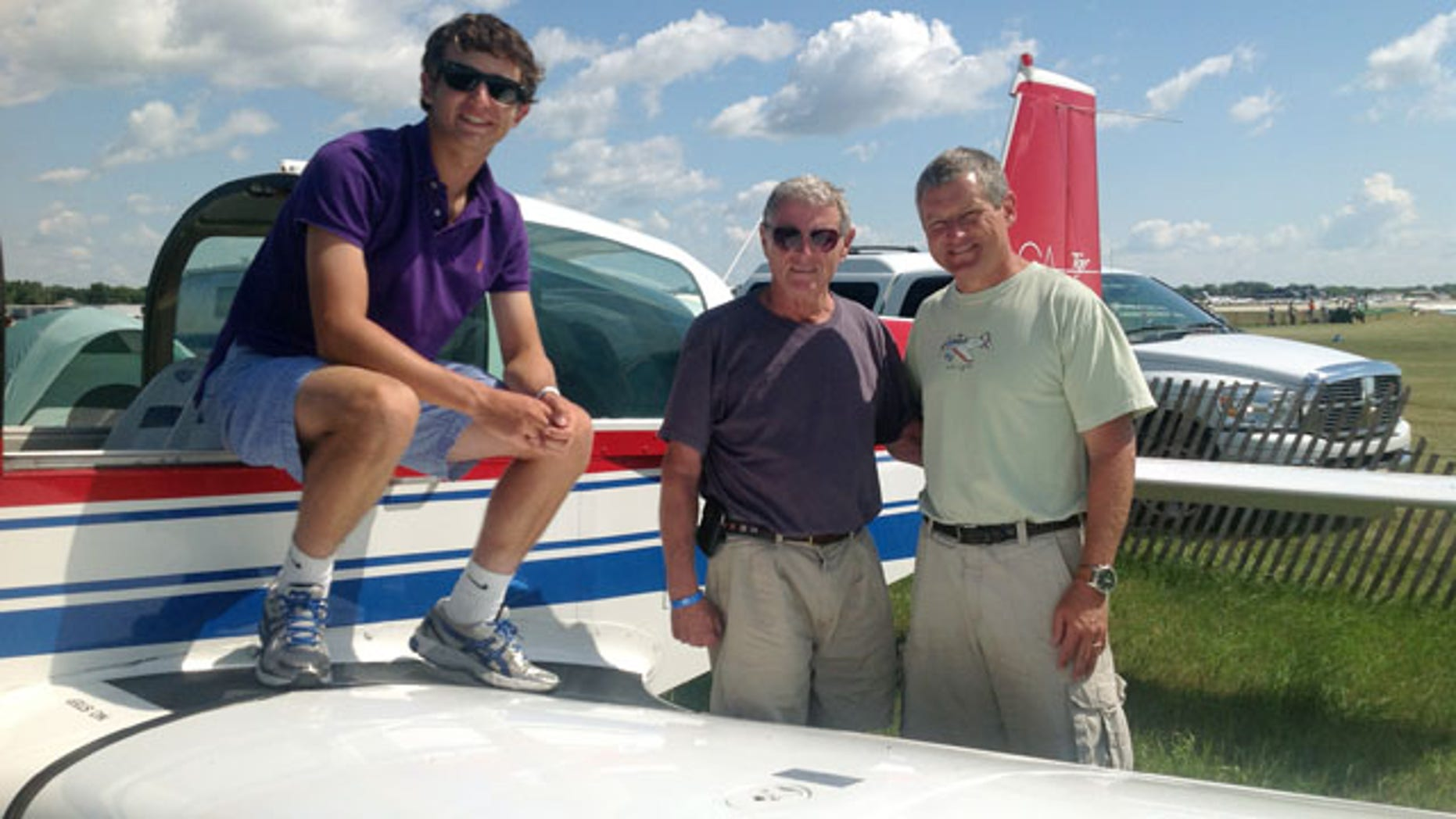 This photo Aug. 1, 2013 photo, courtesy of Sen. James Inhofe, R-Okla., shows from left, Inhofe's grandson Cole Inhofe, Sen. Inhofe and Inhofe's son Perry Inhofe in Oshkosh, Wis. Dr. Perry Inhofe, was killed in a weekend plane crash in northeast Oklahoma. (AP Photo/Courtesy of Sen. James Inhofe, Ryan Jackson)