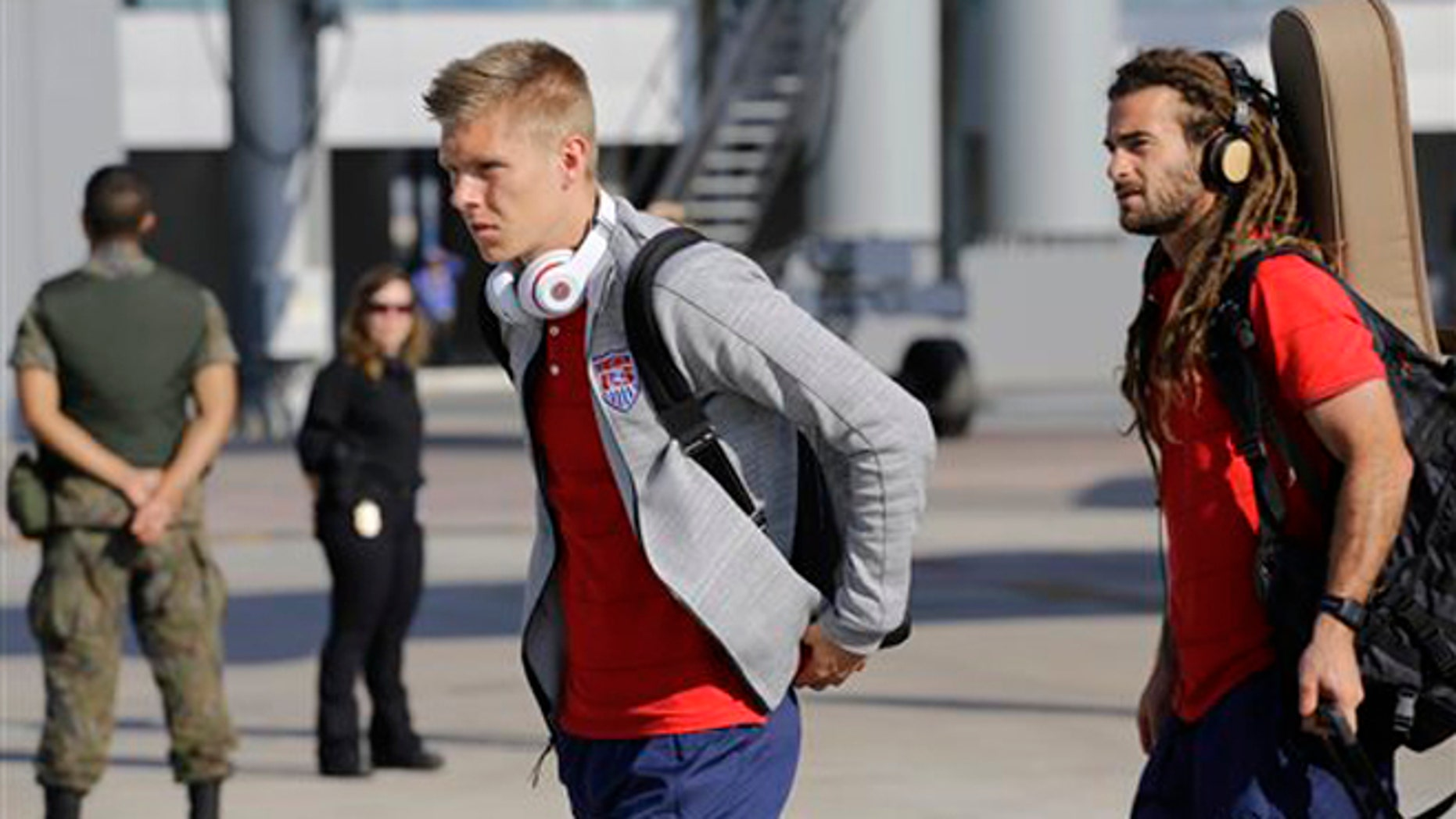 United States' national soccer team players Aron Johannsson, left, and Kyle Beckerman arrives at the Sao Paulo International airport in Brazil, Monday, June 9, 2014. The U.S. team arrived in Sao Paulo to continue their preparations for the upcoming Brazil 2014 World Cup, which starts on June 12. (AP Photo/Nelson Antoine)