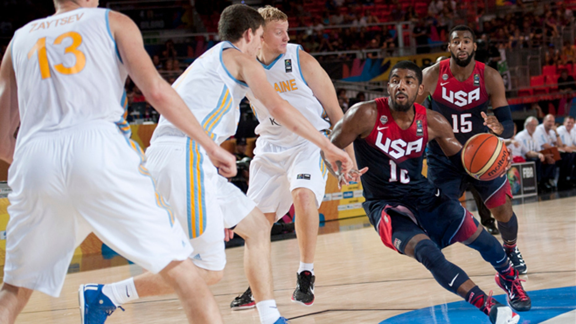 Kyrie Irving of the US goes for the basket between Ukraine players during the Group C Basketball World Cup match, in Bilbao northern Spain, Thursday, Sept. 4, 2014. The 2014 Basketball World Cup competition take place in various cities in Spain from Aug. 30 through to Sept. 14.  United States won 95-71. (AP Photo/Alvaro Barrientos)