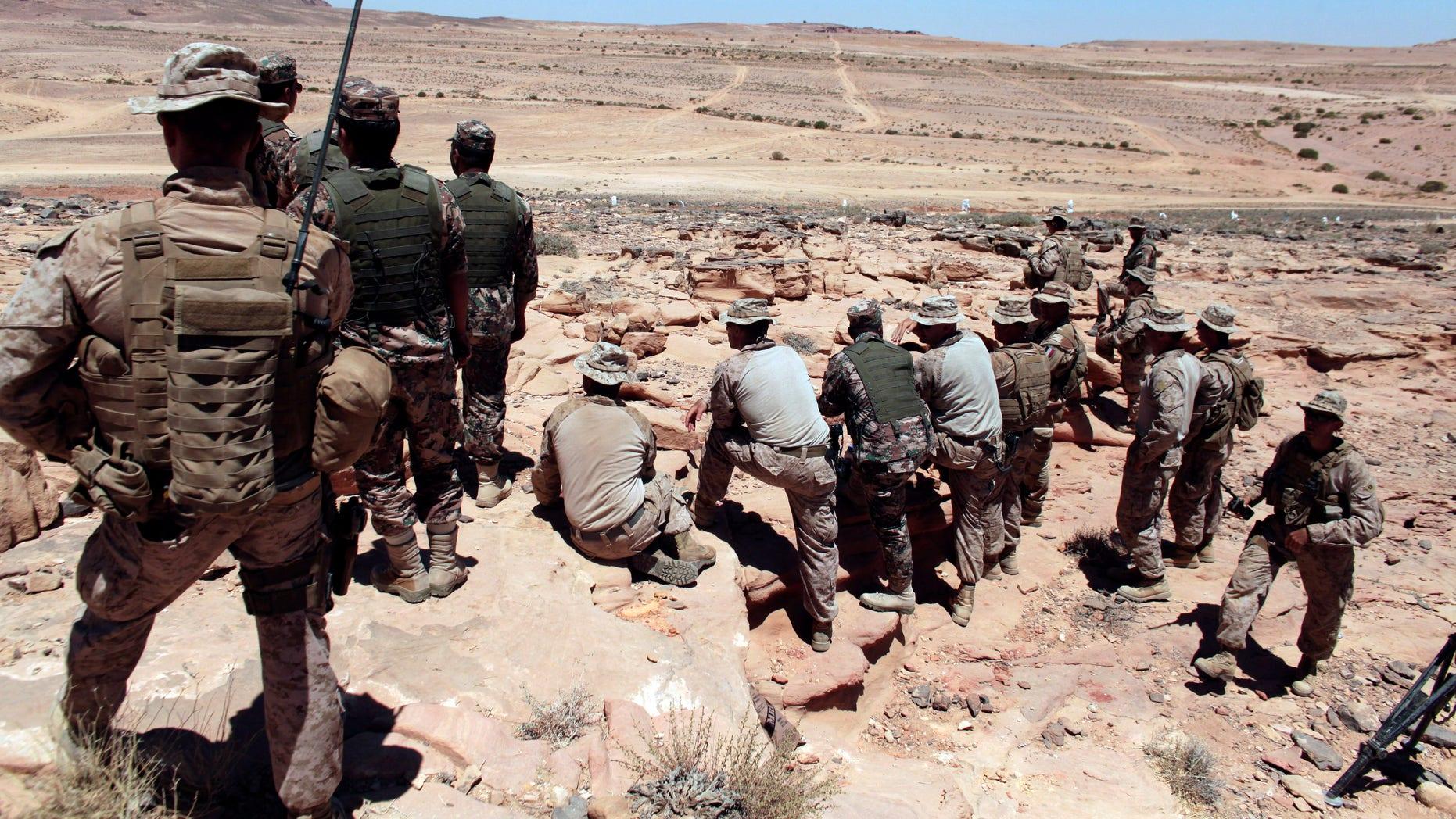 In this June 18, 2013, file photo, U.S. Marines monitor Eager Lion multinational military maneuvers in Quweira, 186 miles south of Amman, Jordan. (AP Photo/Maya Alleruzzo, File)