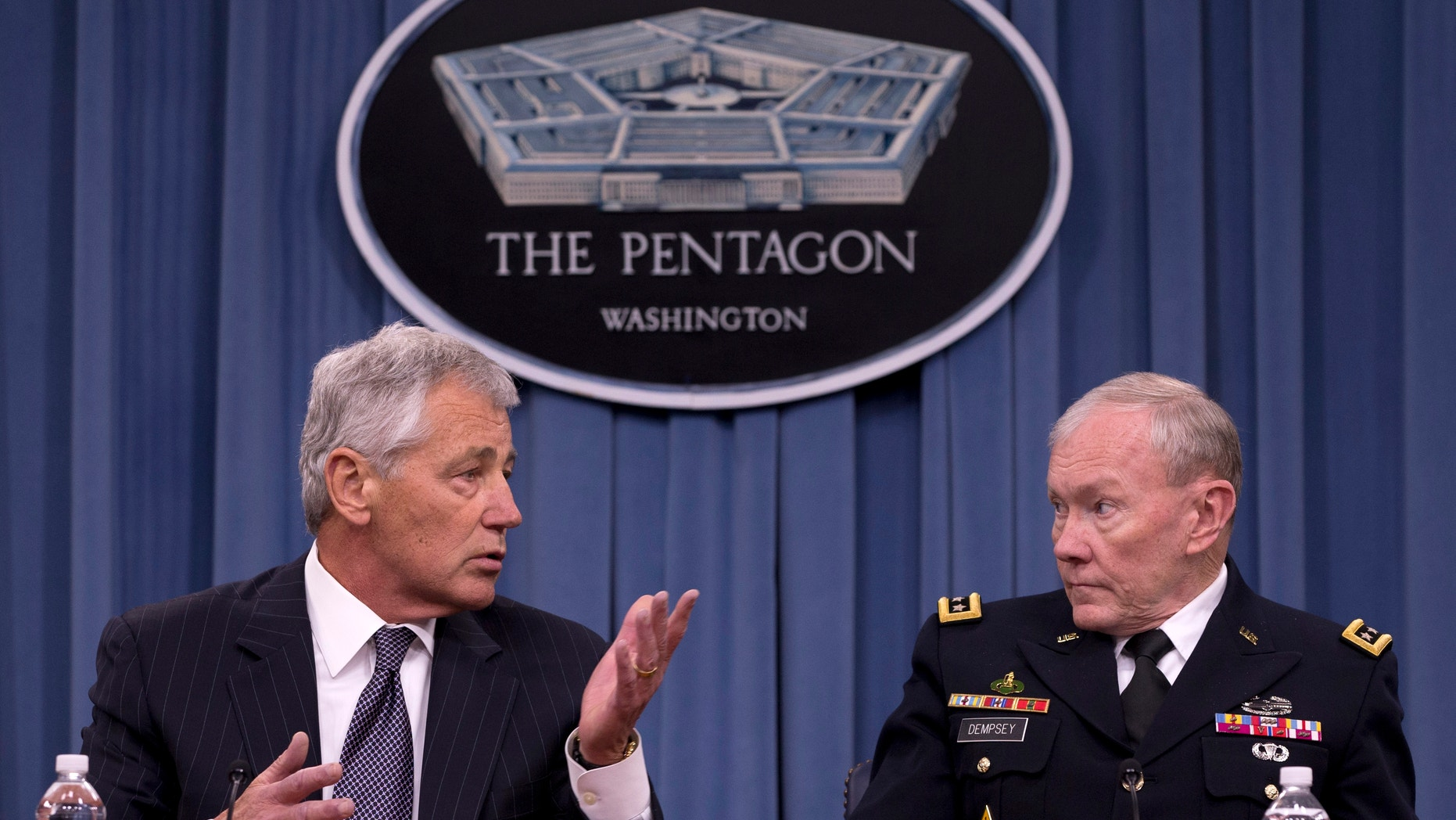 May 17, 2013: Defense Secretary Chuck Hagel, left, accompanied by Joint Chiefs Chairman Gen. Martin Dempsey, gestures as he speaks during a news conference at the Pentagon. The Obama administration is criticizing Russia's decision to provide Syria with anti-ship missiles, which it says will only worsen the civil war.