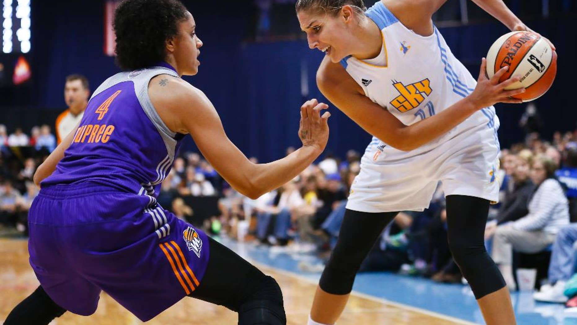 FILE- In this Sept. 12, 2014, file photo, Chicago Sky forward Elena Delle Donne (11) works the ball against Phoenix Mercury forward Candice Dupree (4) during the second half of Game 3 of the WNBA Finals basketball series in Chicago. Delle Donne became the latest post player to withdraw from the U.S. women's basketball team because of injury. (AP Photo/Kamil Krzaczynski, File)