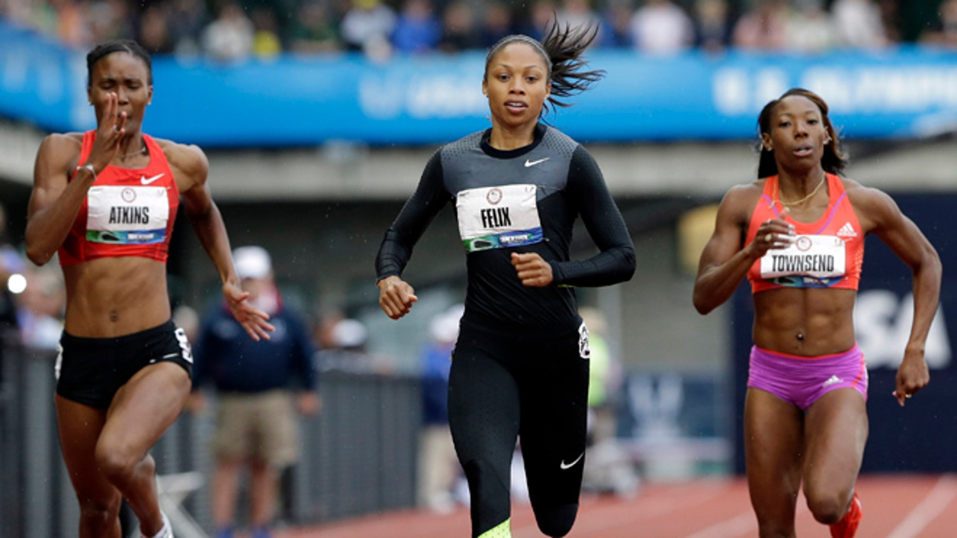 June 28, 2012: Allyson Felix finishes her heat in the women's 200 meters at the U.S. Olympic Track and Field Trials in Eugene, Ore ahead of Joanna Atkins, left, and Tiffany Townsend.