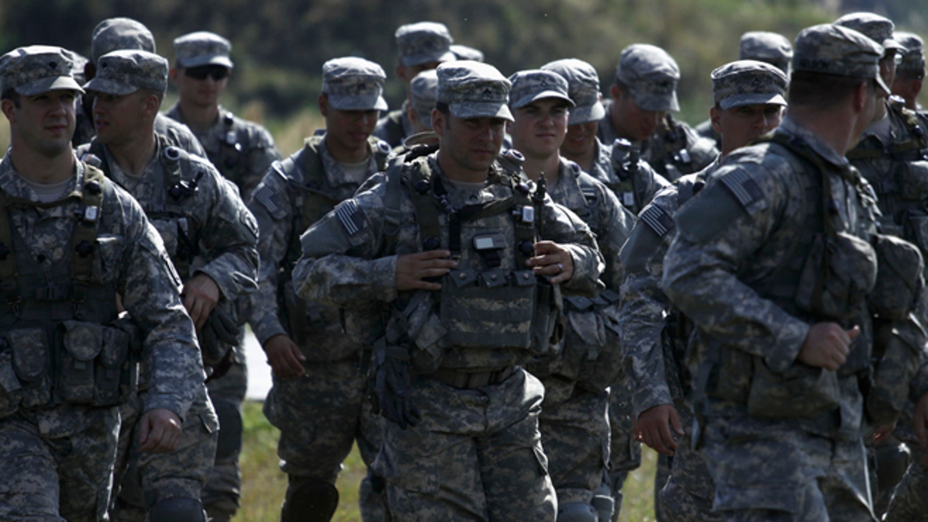 In this Sept. 19, 2014 photo, U.S. servicemen take part in military exercises outside the town of Yavoriv near Lviv, in Ukraine.