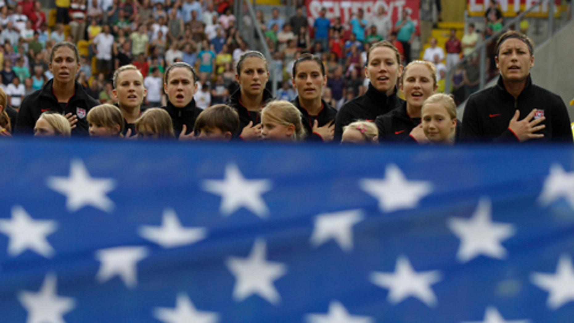 US players sing the nationa anthem prior to the quarterfinal match between Brazil and the United States at the Womens Soccer World Cup in Dresden, Germany, Sunday, July 10, 2011. (AP Photo/Marcio Jose Sanchez)