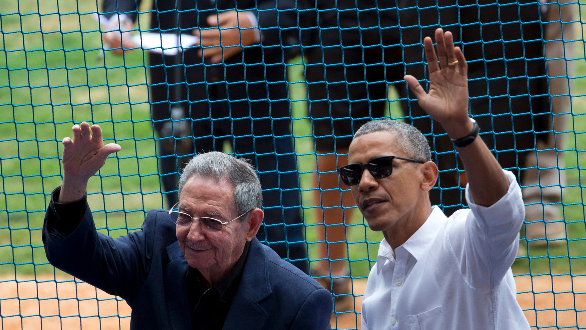 FILE - This March 22, 2016 file photo shows U.S. President Barack Obama, right, and his Cuban counterpart Raul Castro wave to cheering fans as they arrive for a baseball game between the Tampa Bay Rays and the Cuban national baseball team, in Havana, Cuba. Castroââ¬â¢s passing removes what was long the single greatest psychological barrier to a warmer U.S.-Cuban relationship. But it also adds to the uncertainty ahead with the transition from an Obama to Trump administration. (AP Photo/Rebecca Blackwell, File)