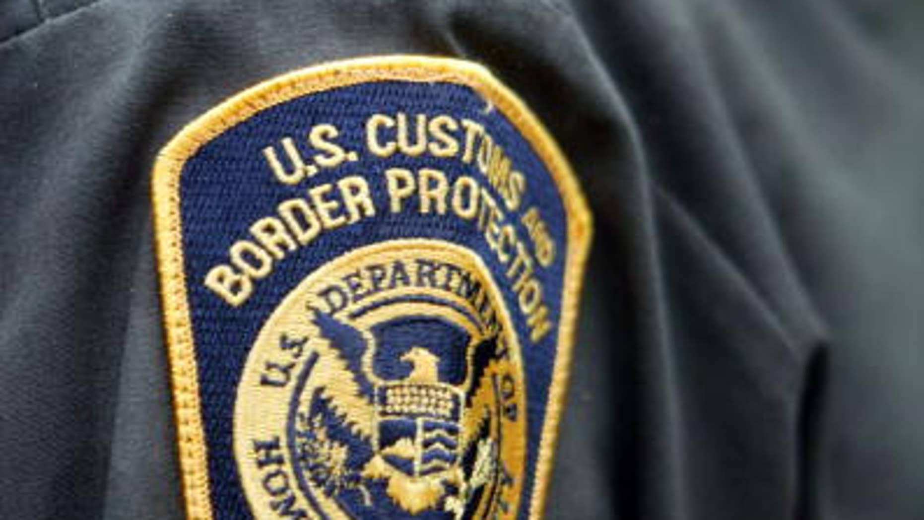 An agent wears the new U.S. Customs and Border Protection patch on his sleeve April 24, 2004 in Aguadilla, Puerto Rico.