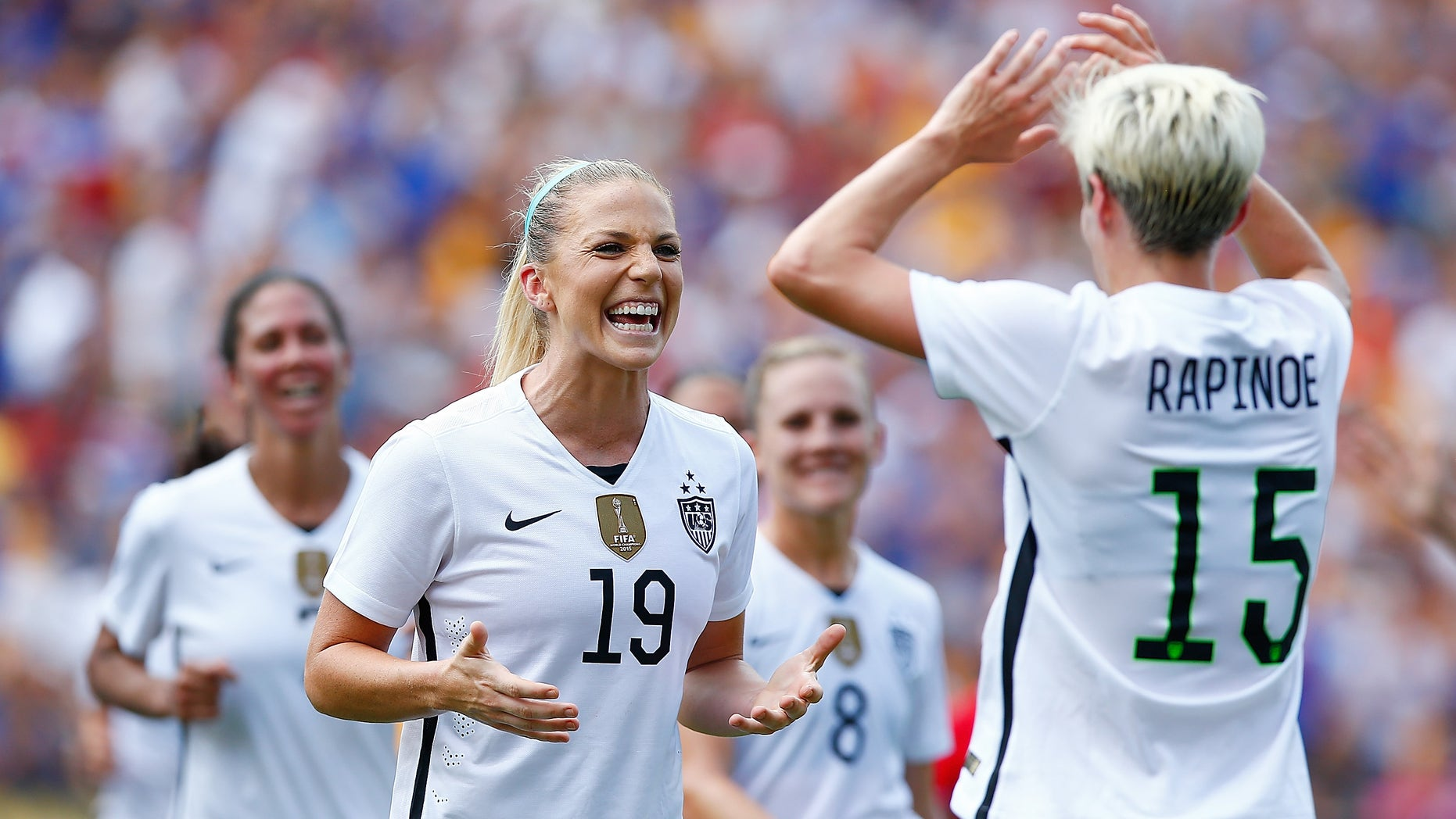 PITTSBURGH, PA - AUGUST 16: Julie Johnston #19 of the United States celebrates her goal with teammate Megan Rapinoe #15 in the first half against Costa Rica during the match at Heinz Field on August 16, 2015 in Pittsburgh, Pennsylvania.  (Photo by Jared Wickerham/Getty Images)