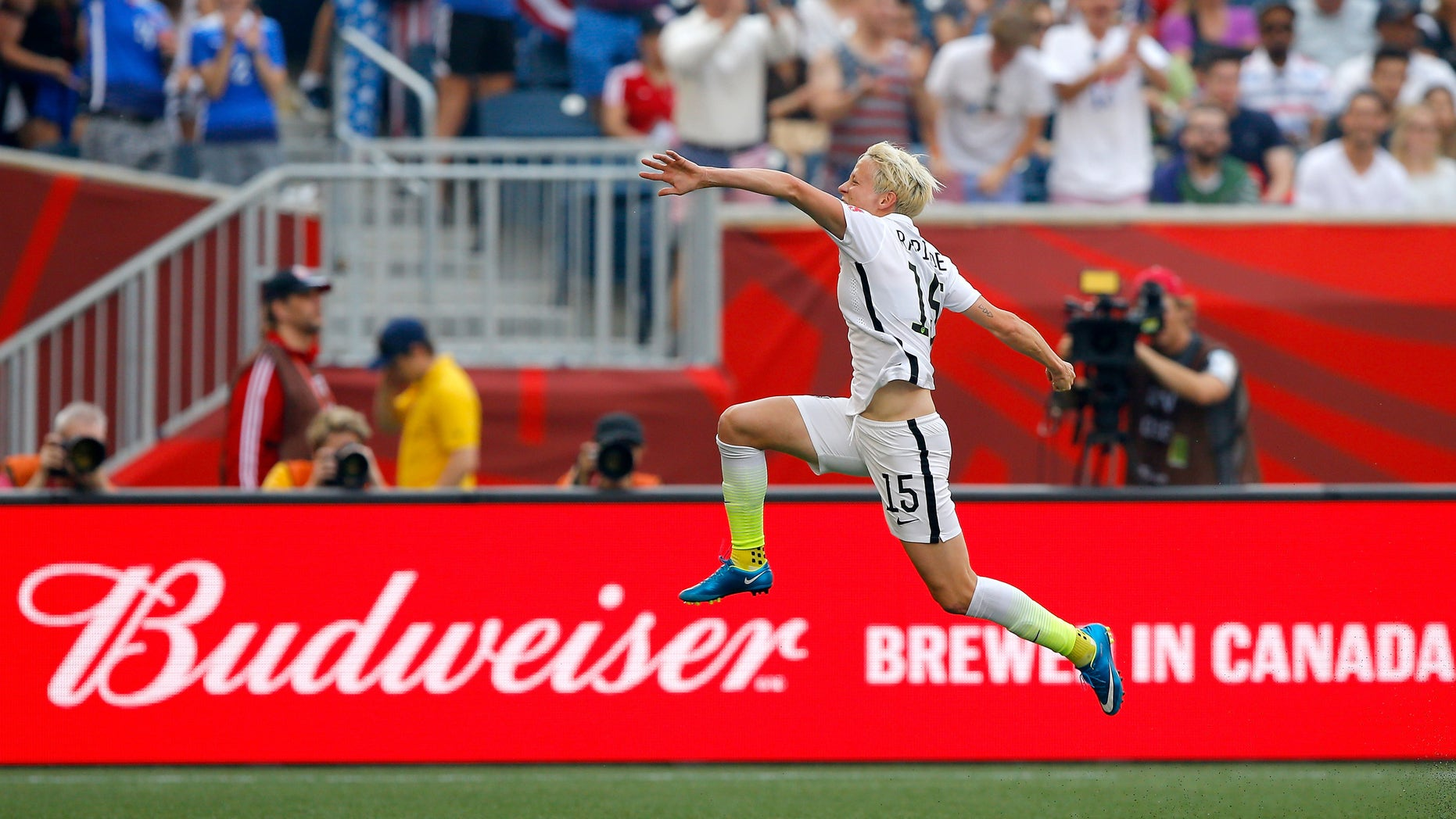 WINNIPEG, MB - JUNE 08:  Megan Rapinoe #15 of United States celebrates her opening goal against Australia in the first half during the FIFA Women's World Cup 2015 Group D match at Winnipeg Stadium on June 8, 2015 in Winnipeg, Canada.  (Photo by Kevin C. Cox/Getty Images)