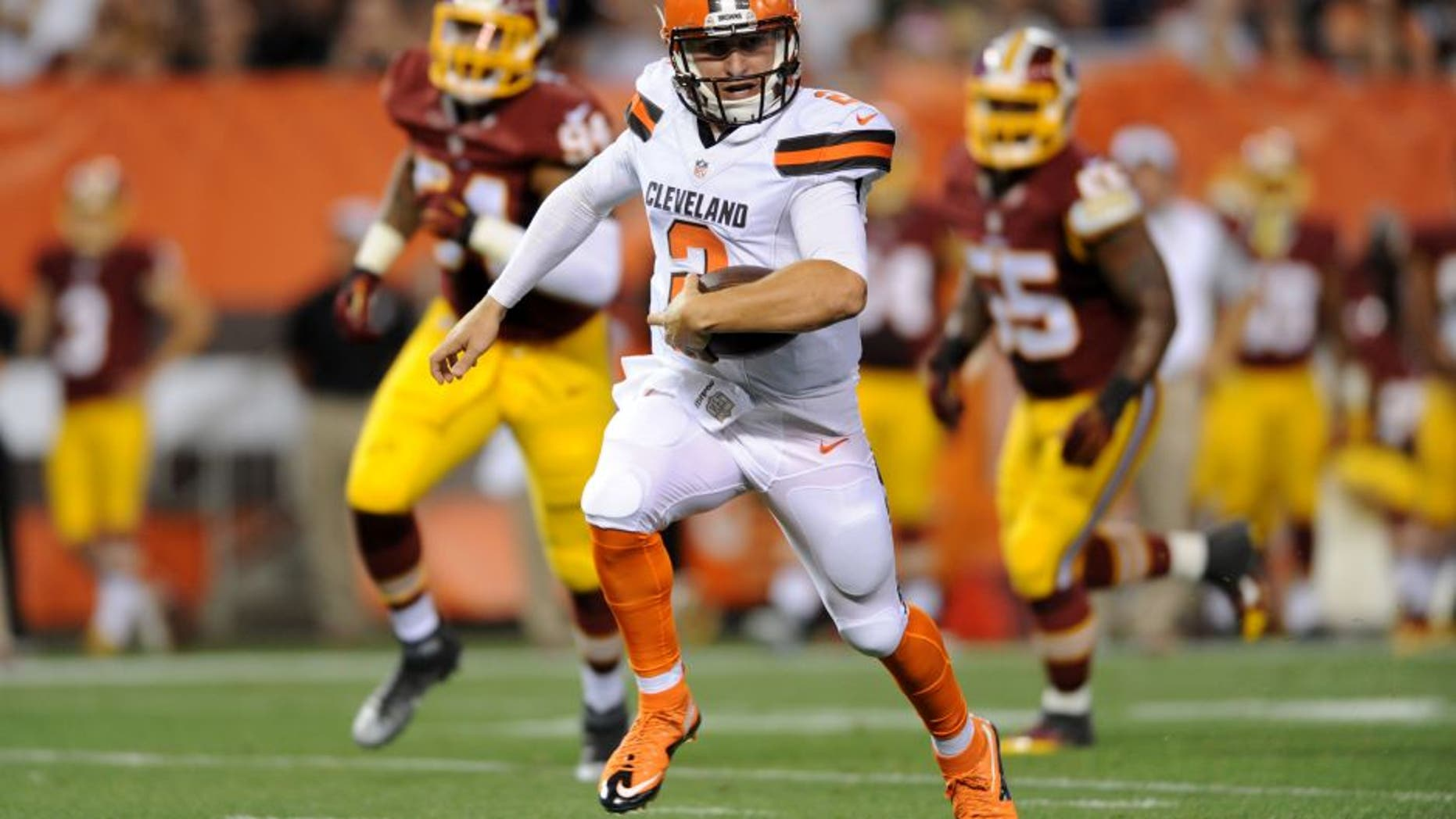 Aug 13, 2015; Cleveland, OH, USA; Cleveland Browns quarterback Johnny Manziel (2) runs for a touchdown during the second quarter against the Washington Redskins in a preseason NFL football game at FirstEnergy Stadium. Mandatory Credit: Ken Blaze-USA TODAY Sports