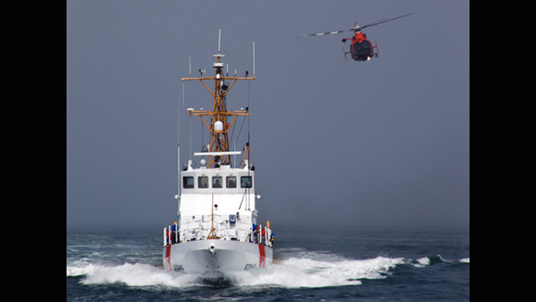 Aug. 29, 2011: CG-6501 (A HH-65 Rescue Helicopter from Airs Station Los Angeles) conducts a close fly-by of CGC HALIBUT as part of their joint efforts during a Koru-Care visit. Koru-care is a program that makes wishes happen for terminally ill children from New Zealand.