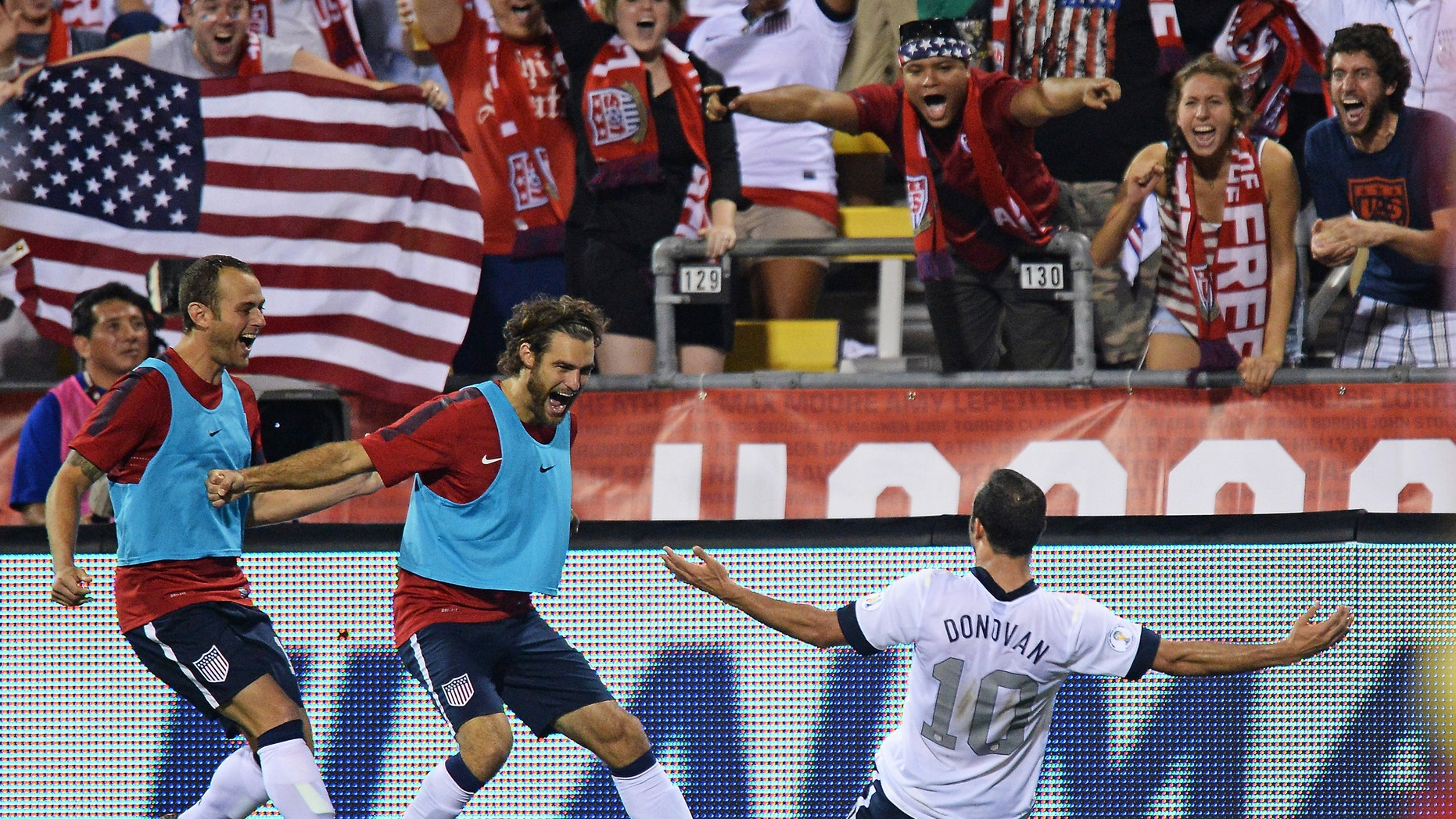 COLUMBUS, OH - SEPTEMBER 10:  Landon Donovan #10 of the United States Men's National Team celebrates his second half goal against Mexico with teammates Brad Davis #17 of the United States MenÃs National Team, far left, and Graham Zusi #19 of the United States MenÃs National Team, middle, at Columbus Crew Stadium on September 10, 2013 in Columbus, Ohio. The United States defeated Mexico 2-0.  (Photo by Jamie Sabau/Getty Images)