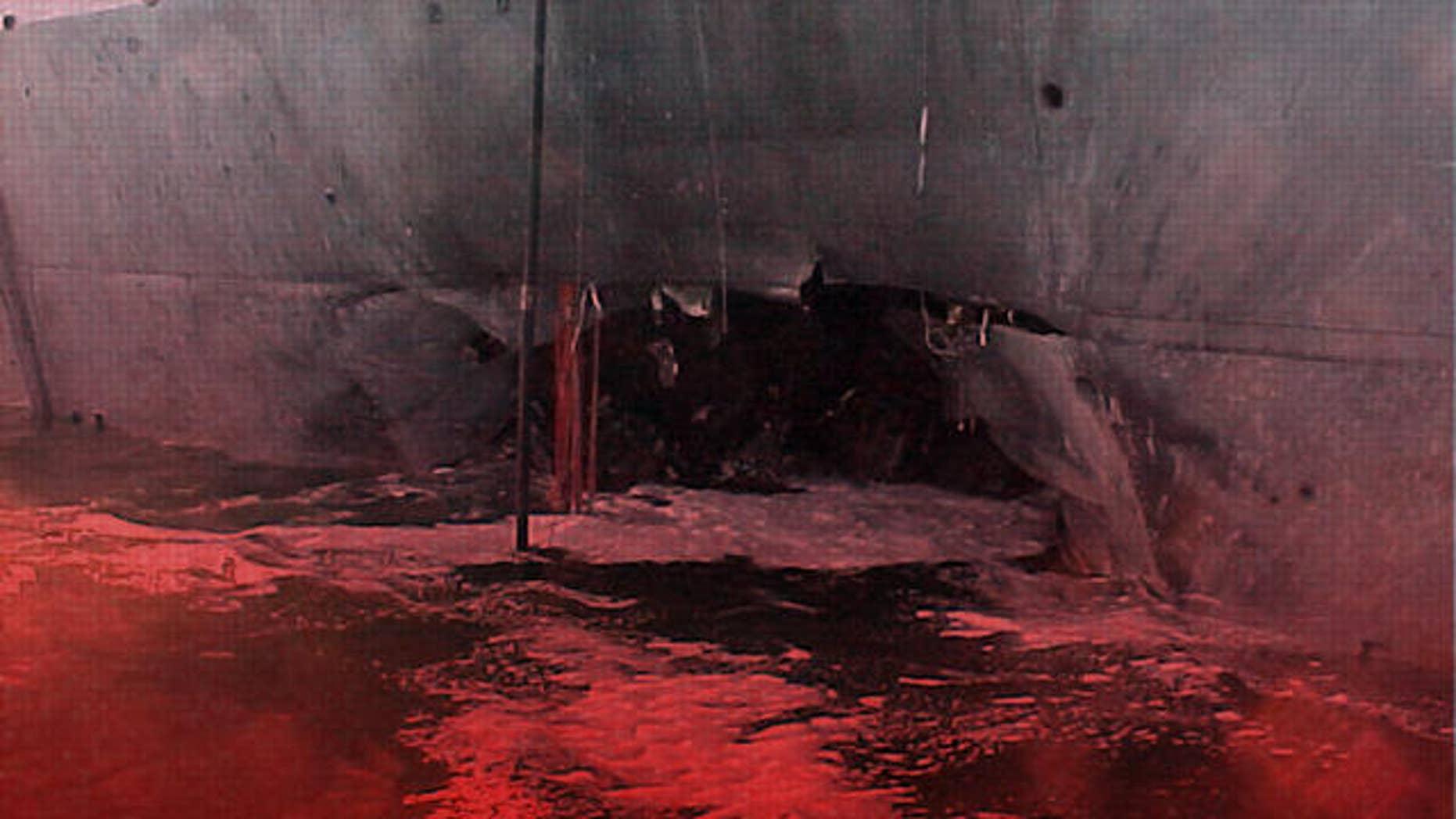 Damage to USS Cole destroyer at port of Aden, Yemen,  (AP)