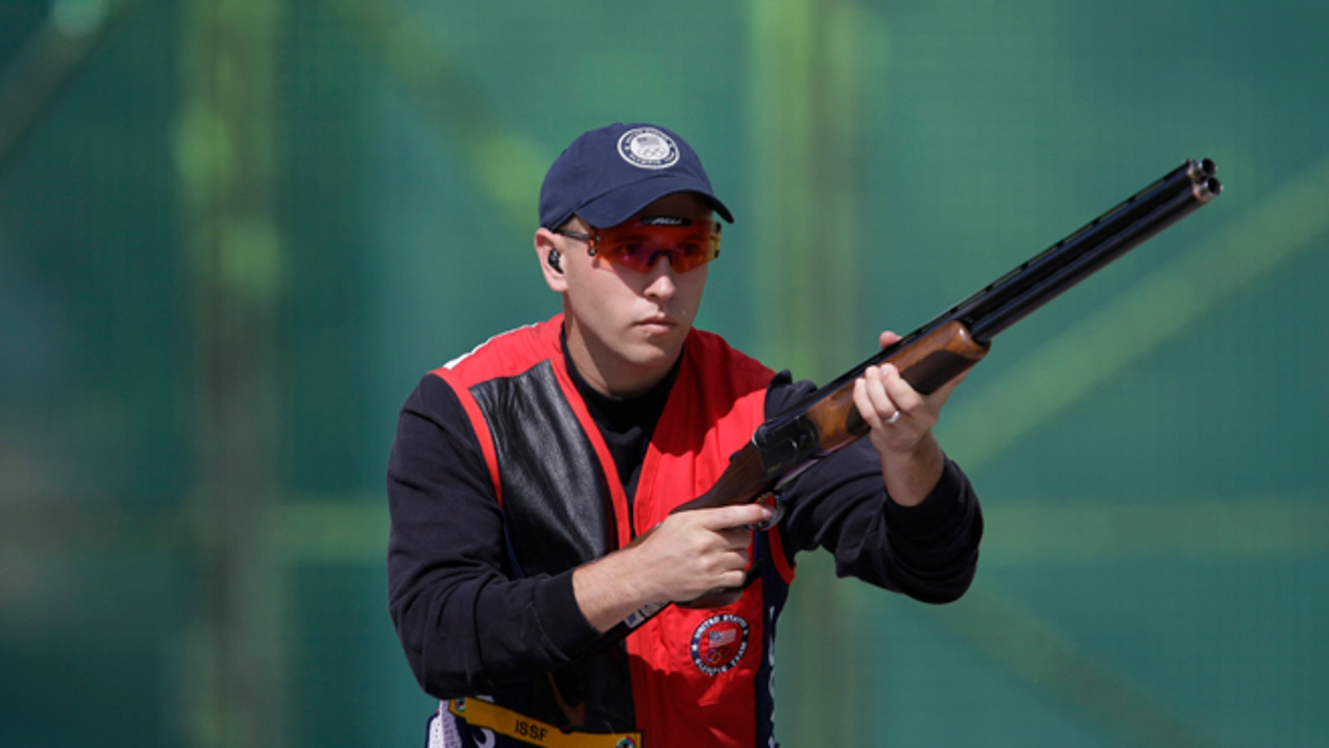 July 30, 2012: United States of America's Vincent Hancock prepares to shoot during the first day of qualifiers for the men's skeet event at the 2012 Summer Olympics in London.