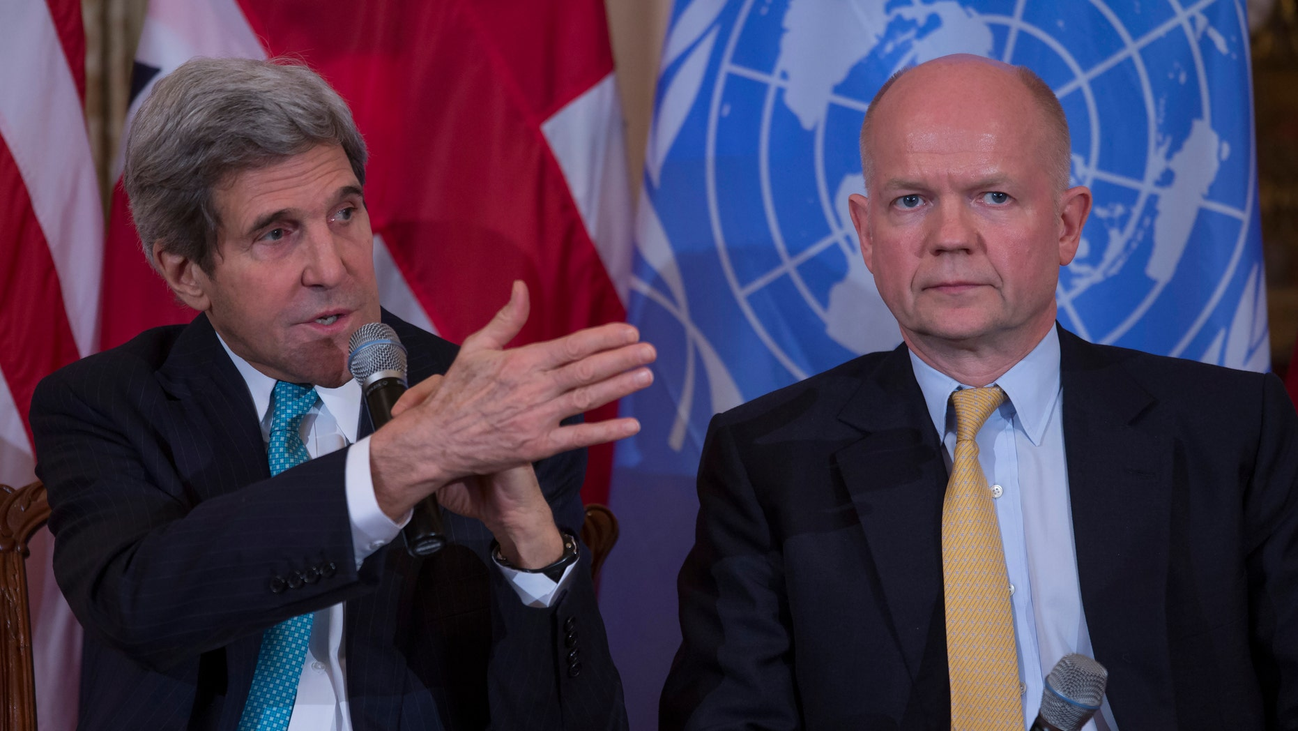 Feb. 25, 2014: British Foreign Secretary William Hague listens at right as Secretary of State John Kerry speaks at the State Department in Washington.