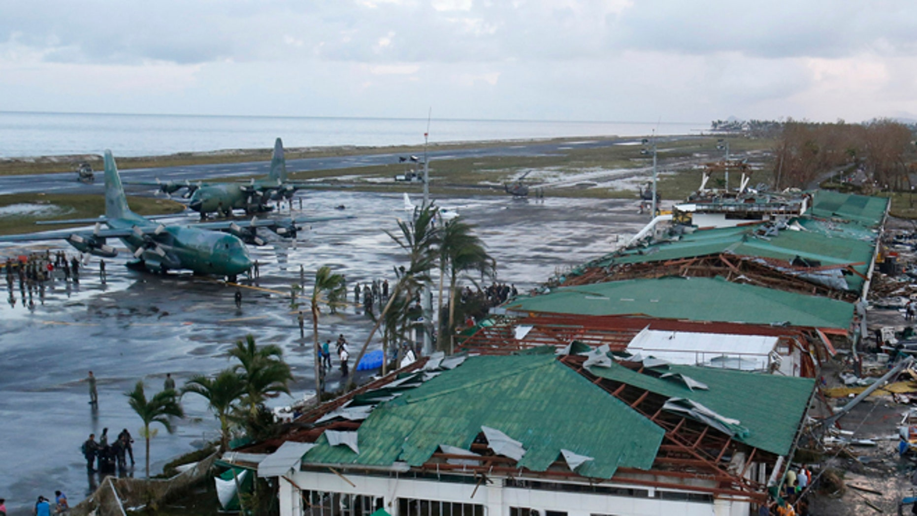 FILE: Nov. 9, 2013: Philippine military C130 cargo planes ferrys supplies park at the tarmac outside an airport after super Typhoon Haiyan battered Tacloban city in central Philippines.