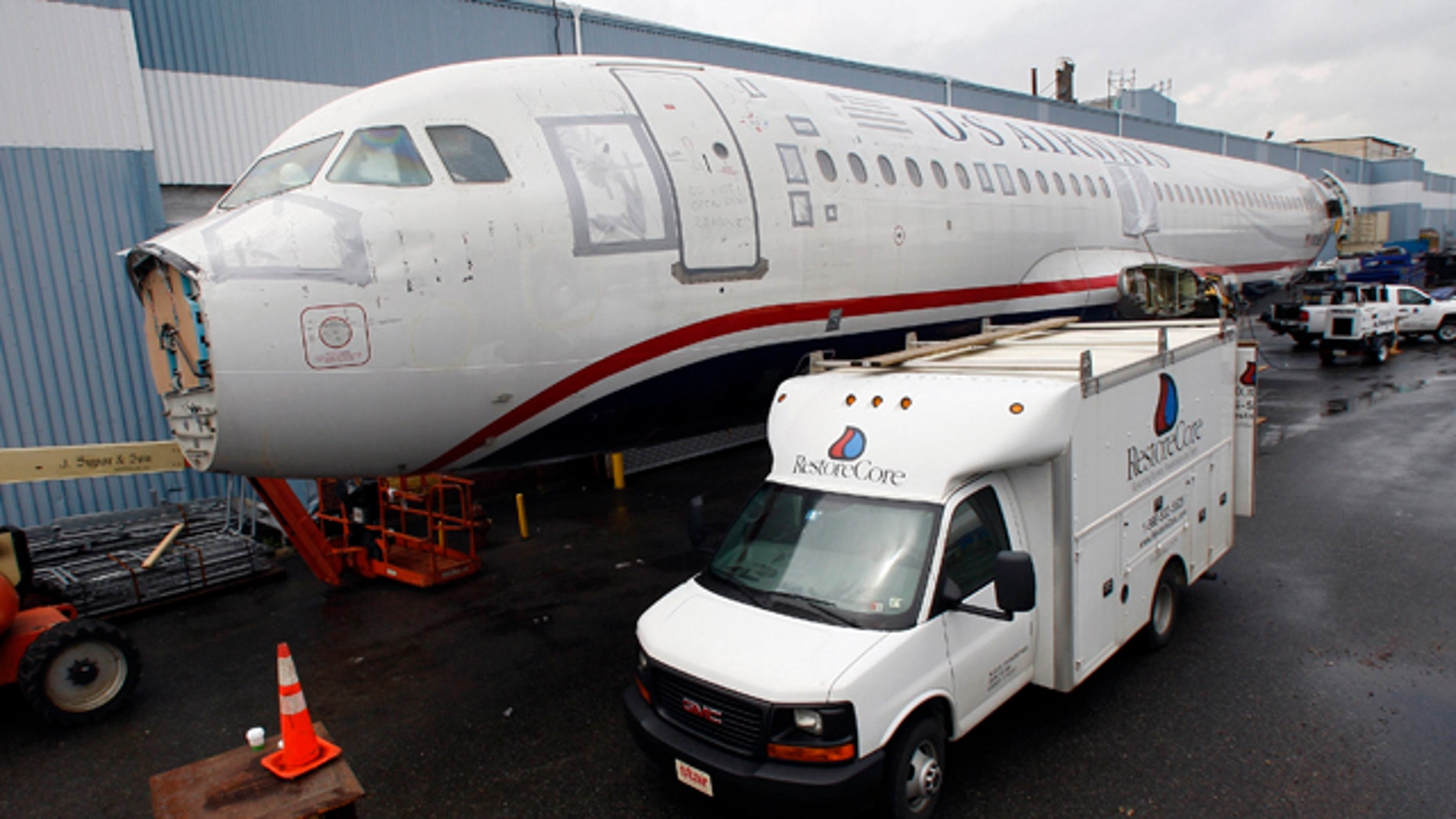 May 20: The US Airways jet, flight 1549, sits outside a warehouse at J. Supor and Sons in Harrison, N.J. The plane that splash-landed in the Hudson River in 2009, making a national hero of pilot, is getting a final once-over before it makes its last journey.