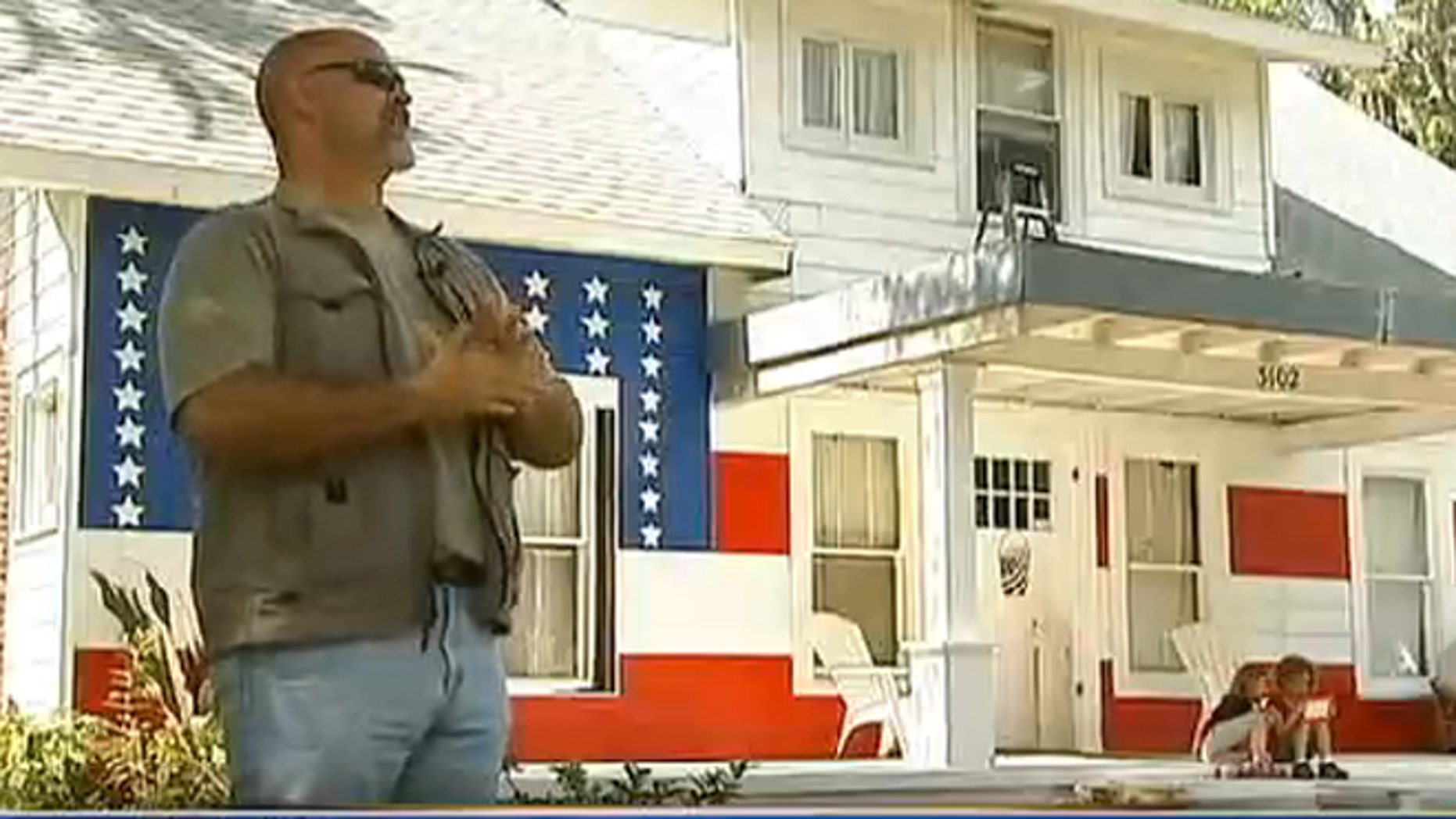 Brent Greer said he painted his Florida home red, white and blue to protest unfair fines.