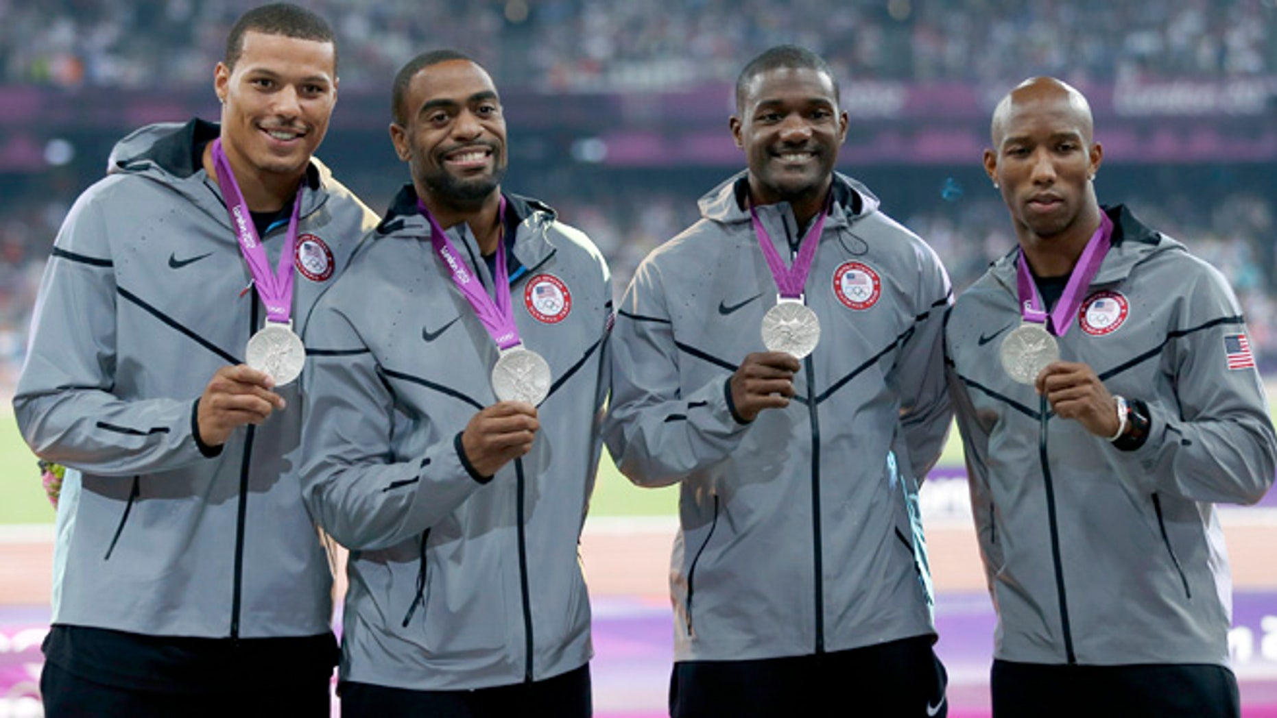 Aug. 11, 2012: Silver medalists (R-L) Trell Kimmons, Justin Gatlin, Tyson Gay and Ryan Bailey of the U.S. pose after receiving their medals for the men's 4x100m relay during the London 2012 Olympic Games at the Olympic Stadium.