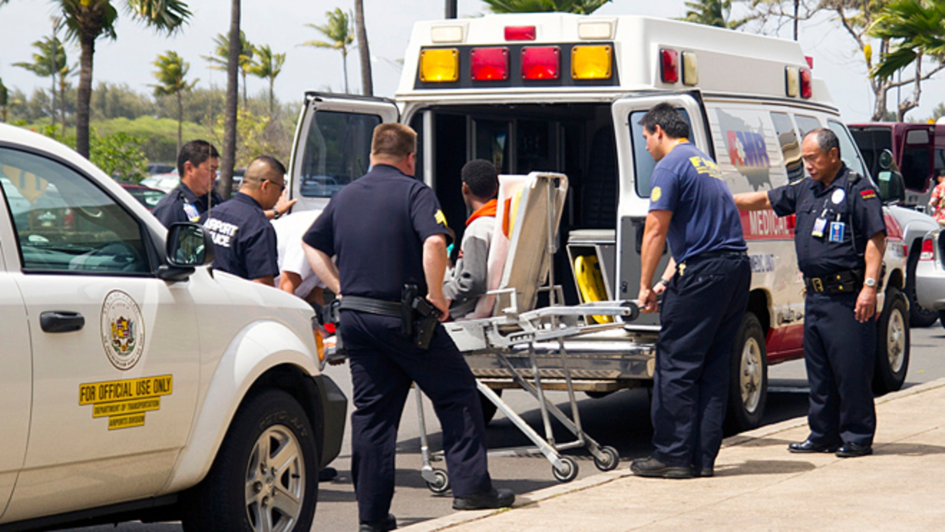 April 20, 2014: In this file photo, a 15-year-old boy, seen sitting on a stretcher center, who stowed away in the wheel well of a flight from San Jose, Calif., to Maui is loaded into an ambulance at Kahului Airport in Kahului, Maui, Hawaii.