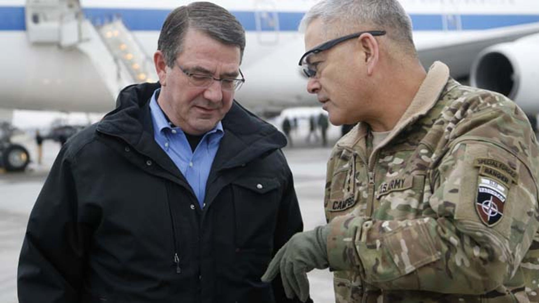 Feb. 21, 2015: In this file photo, U.S. Secretary of Defense Ash Carter, left, walks with U.S. Army Gen. John Campbell upon arrival at Hamid Karzai International Airport in Kabul, Afghanistan. (AP)