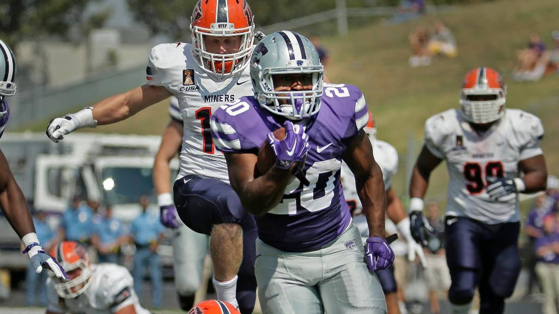 Kansas State running back DeMarcus Robinson (20) is chased by UTEP defenders as he runs for a touchdown during the second half of an NCAA college football game, Saturday, Sept. 27, 2014, in Manhattan, Kan. (AP Photo/Charlie Riedel)