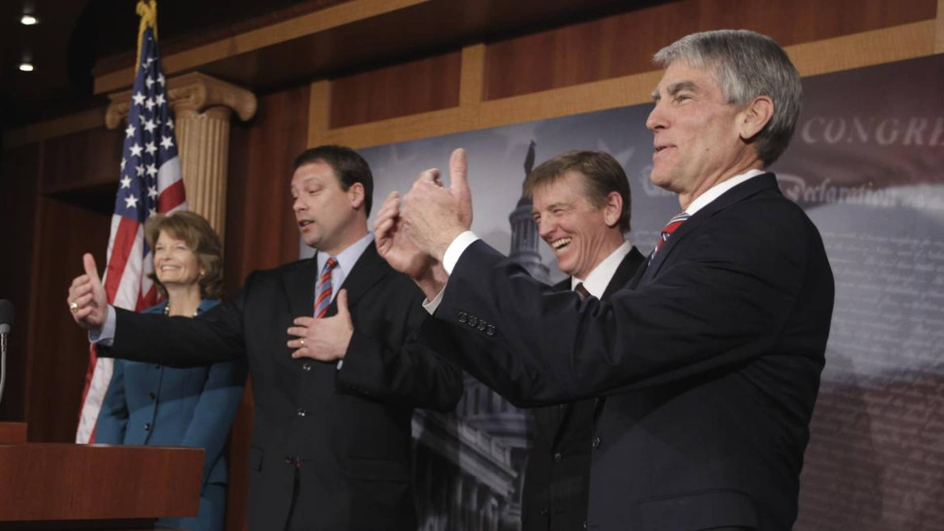 From left, Sen. Lisa Murkowski, R-Alaska, Rep. Heath Shuler, D-N.C., Rep. Paul Gosar, R-Ariz, and Sen. Mark Udall, D-Colo.,take part in a news conference on Capitol Hill in Washington, Tuesday, Jan. 25, 2011, to discuss Democrats and Republicans sitting together during President Barack Obama's State of the Union speech. (AP Photo/Charles Dharapak)