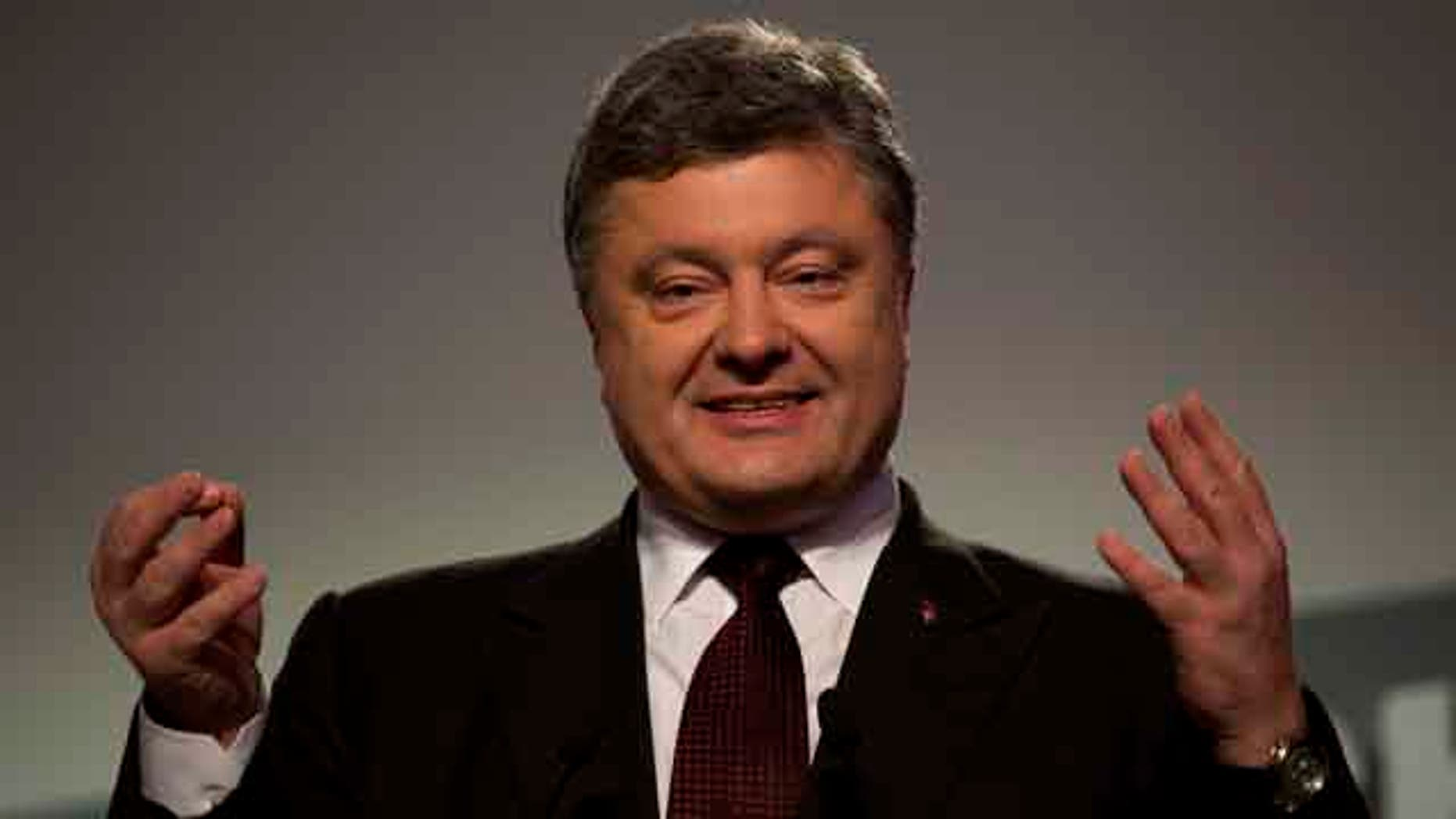 October 26, 2014: Ukrainian President Petro Poroshenko at a press conference following the parliamentary elections in Kiev. Exit polls indicate Ukrainians overwhelmingly voted for several pro-Western parties in a landmark parliamentary election Sunday.