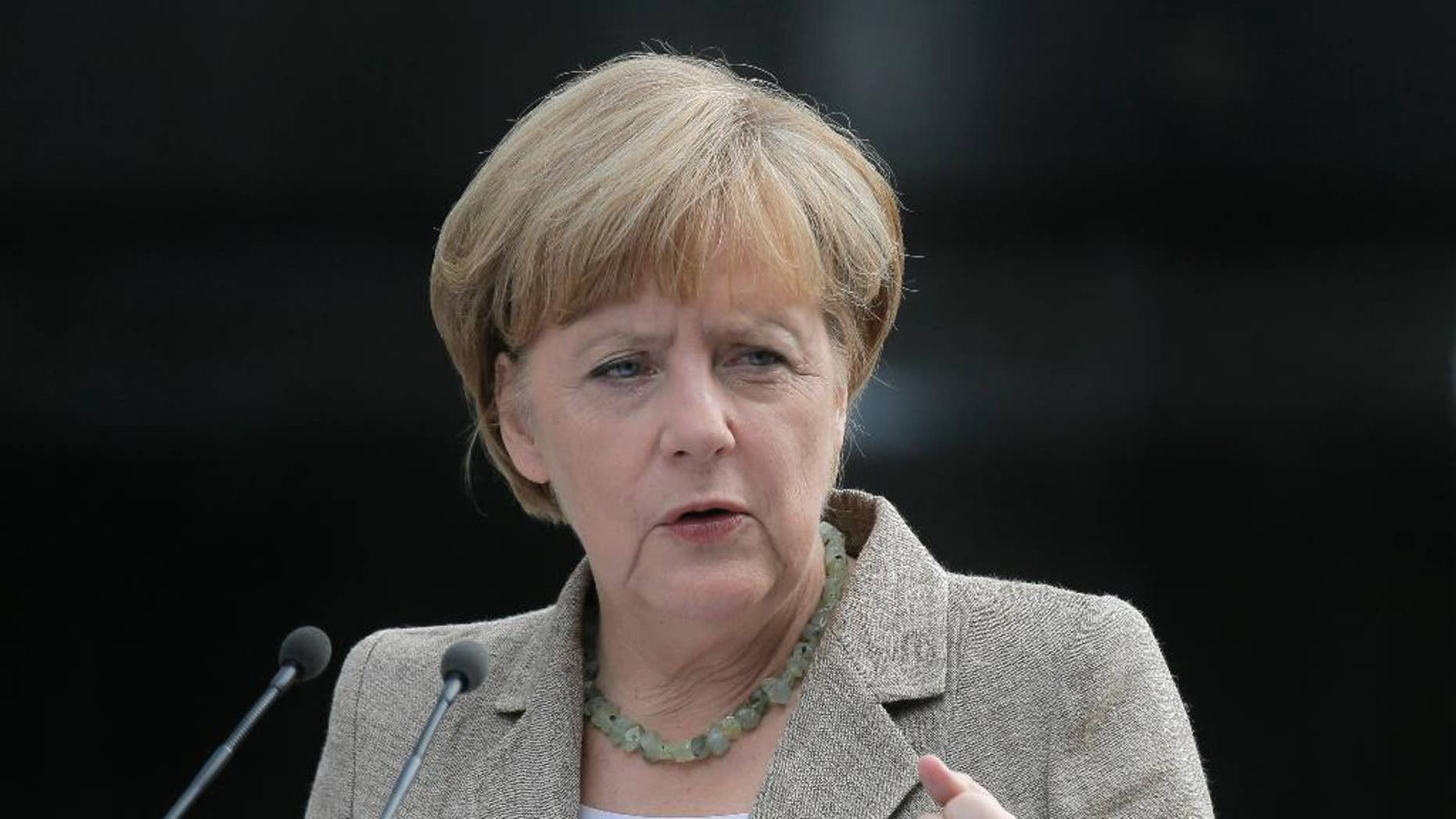 German chancellor Angela Merkel make a statement to the press in Kiev, Ukraine, Saturday, Aug. 23, 2014. German Chancellor Angela Merkel, who has advocated a measured European Union response to Russia's aggressive policies in Ukraine, met Saturday in Kiev to meet Ukrainian President Petro Poroshenko and said she urged a political solution to the crisis. Poroshenko, for his part, said Ukraine was willing to try to solve the conflict by talks, but not at the expense of the country's territorial integrity or sovereignty.  (AP Photo/Efrem Lukatsky)