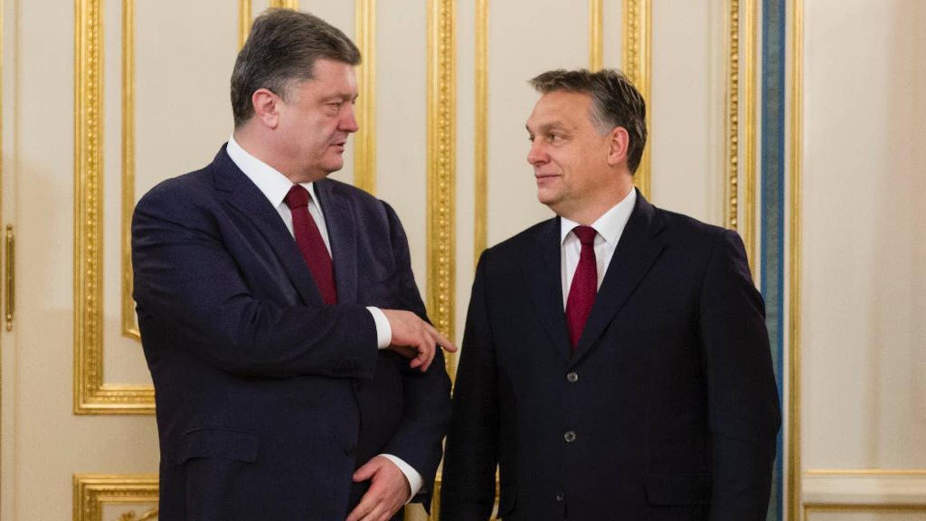 Ukraine's President Petro Poroshenko, left, talks with Hungarian Prime Minister Viktor Orban in Kiev, Ukraine, Friday, Feb. 13, 2015. (AP Photo/Mikhail Palinchak, Pool)