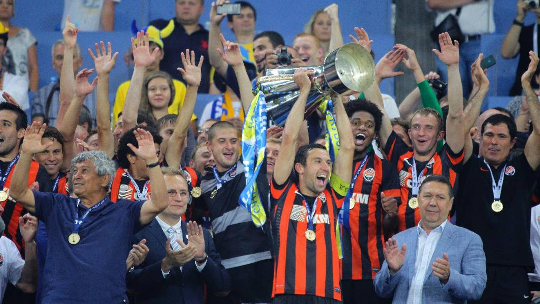 Dario Srna of Shakhtar Donetsk lifts up Ukraine's soccer Super Cup after their victory against Dynamo Kiev at Lviv Arena in Lviv, Ukraine, Tuesday, July 22, 2014.  (AP Photo/Andrey Lukatsky)