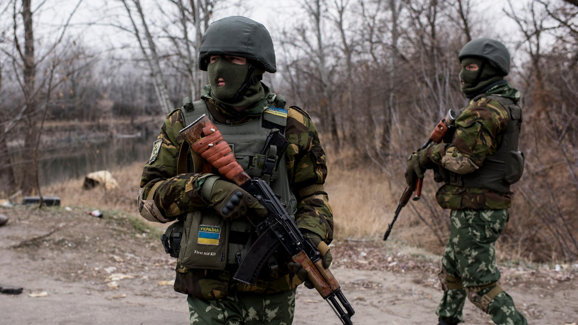 Nov 23, 2014 - FILE photo of Ukrainian servicemen near a bridge over the river Siverskiy Donets, damaged by explosion during fighting between Pro-Russian rebels and Ukrainian government forces near Trehizbenka village, Luhansk region eastern Ukraine. More than 4,700 people have died in fighting in eastern Ukraine over the past half year, according to UN estimates. (AP)