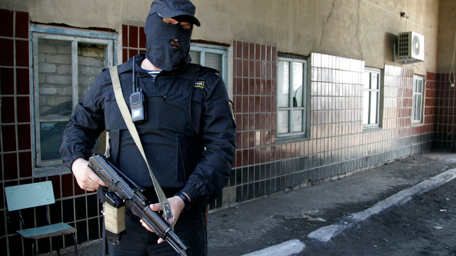 May 16, 2014 - An armed man of the Donbass Battalion, a non-affiliated militia group that has stated its intent to fight in support of Ukrainian unity, is on guard at a base near Donetsk, eastern Ukraine.  The group says it has reclaimed Velyka Novosilka from pro-Russian separatists with the self-styled Donetsk Peoples Republic, an anti-government movement that has over the past few weeks been seizing government offices and declared its intent to merge the Donetsk region with Russia.