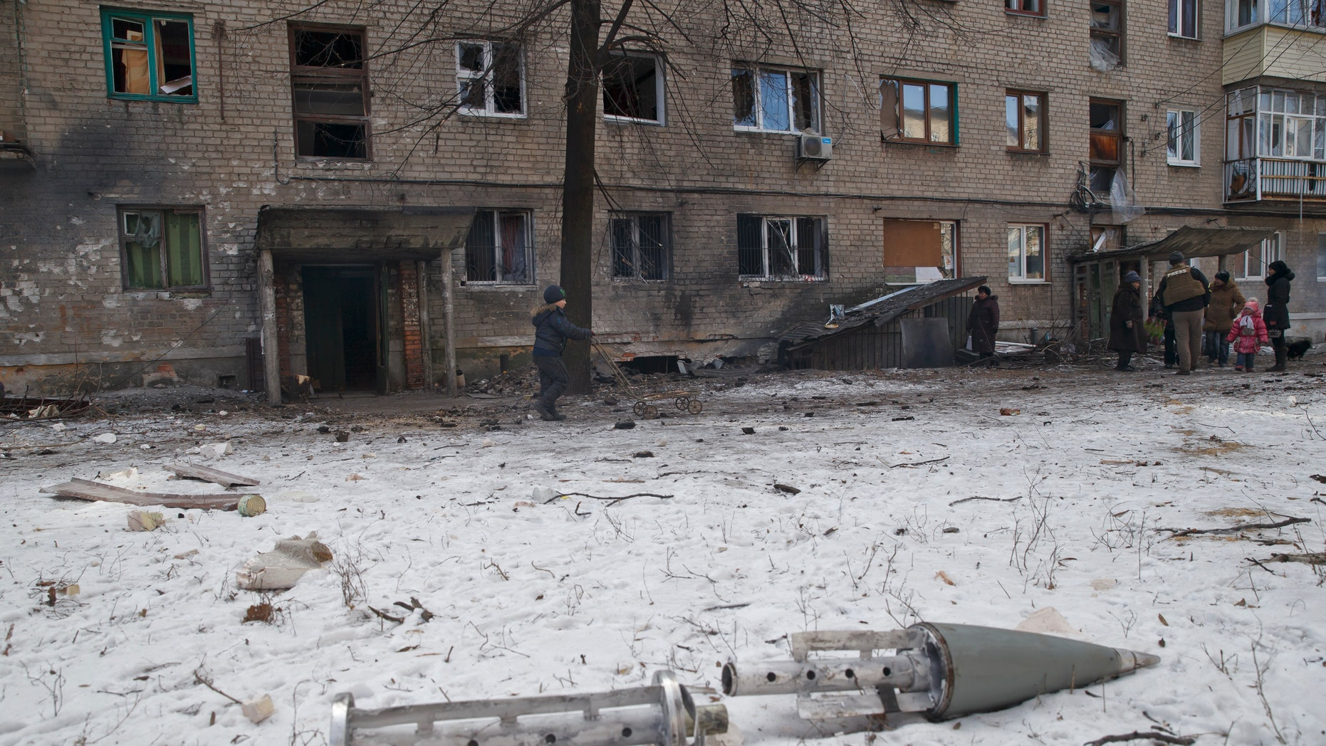 Feb. 20, 2015 - The remains of a rocket outside damaged apartment building in Debaltseve, Ukraine. After weeks of relentless fighting, Debaltseve fell Wednesday to Russia-backed separatists.