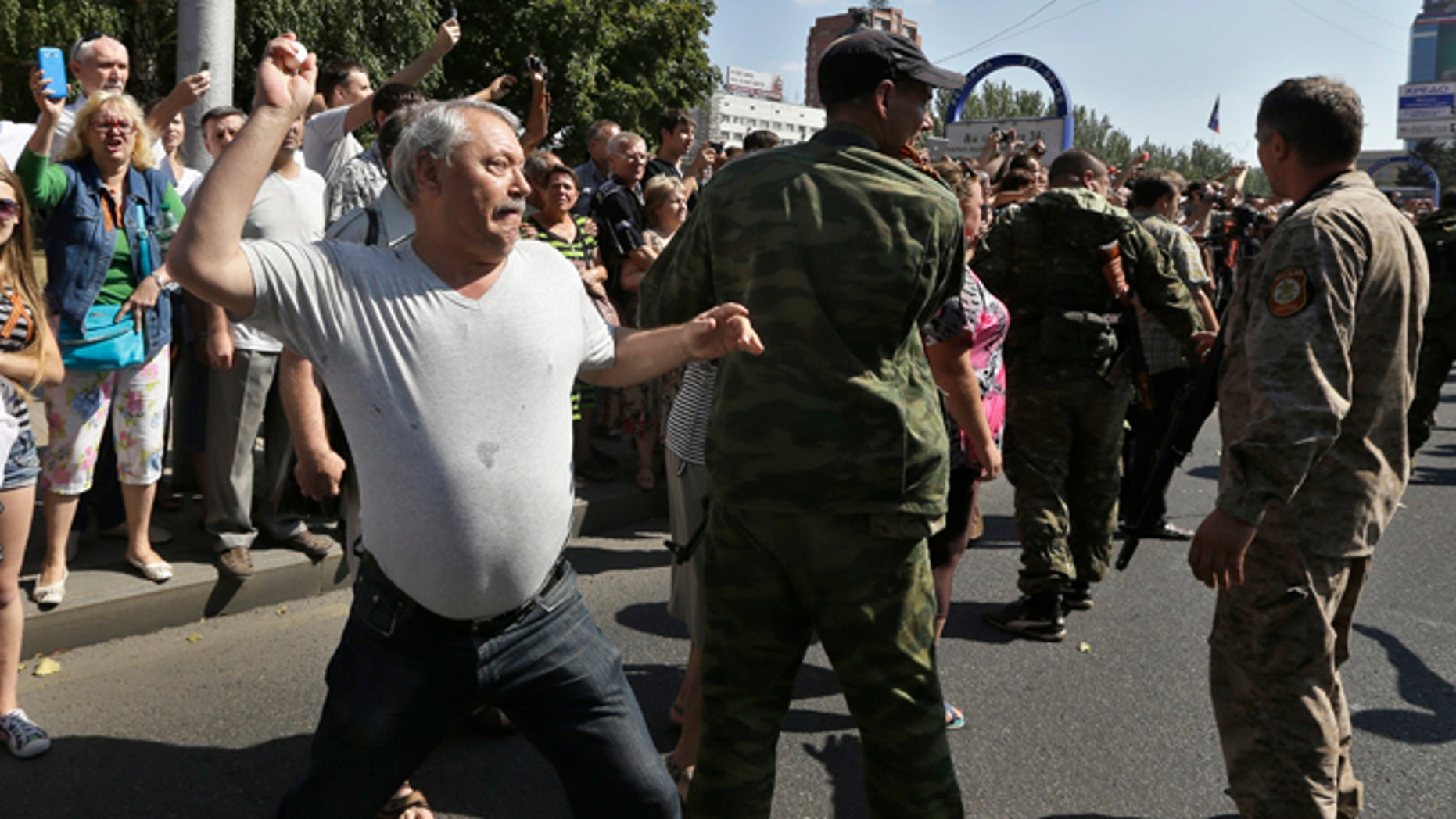 Aug. 24, 2014: A man throws an egg at captured Ukrainian army prisoners as they're escorted by Pro-Russian rebels in a central square in Donetsk, eastern Ukraine. (AP)