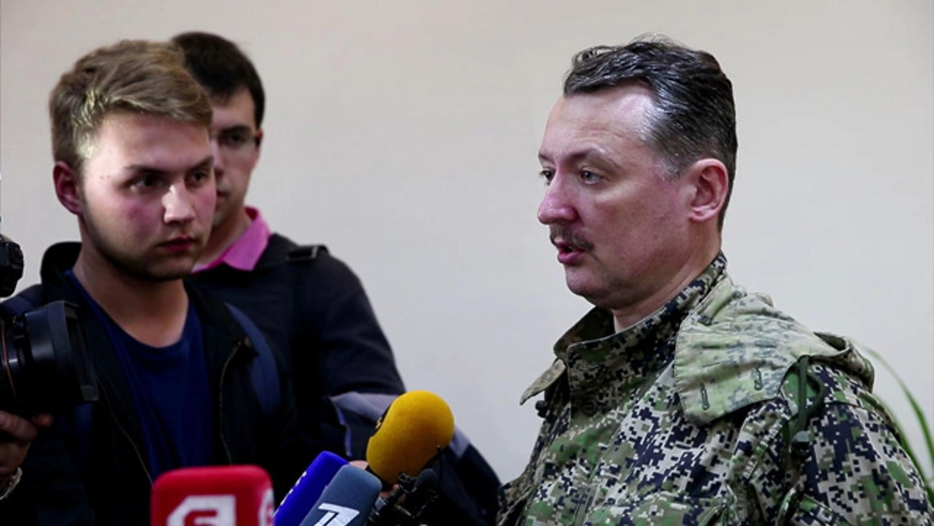 April 27, 2014: This image taken from Associated Press video shows Igor Strelkov, military commander of pro-Russian militias in Slovyansk, talking to journalists in Ukraine.