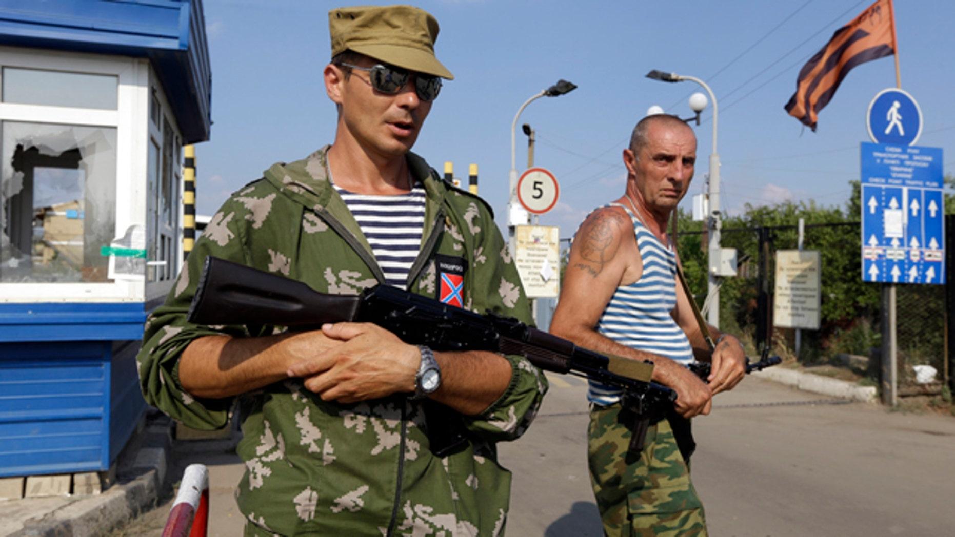 August 16, 2014: Pro-Russian rebels guard a border crossing point 'Izvaryne' on Ukraine-Russia border. (AP Photo/Sergei Grits)