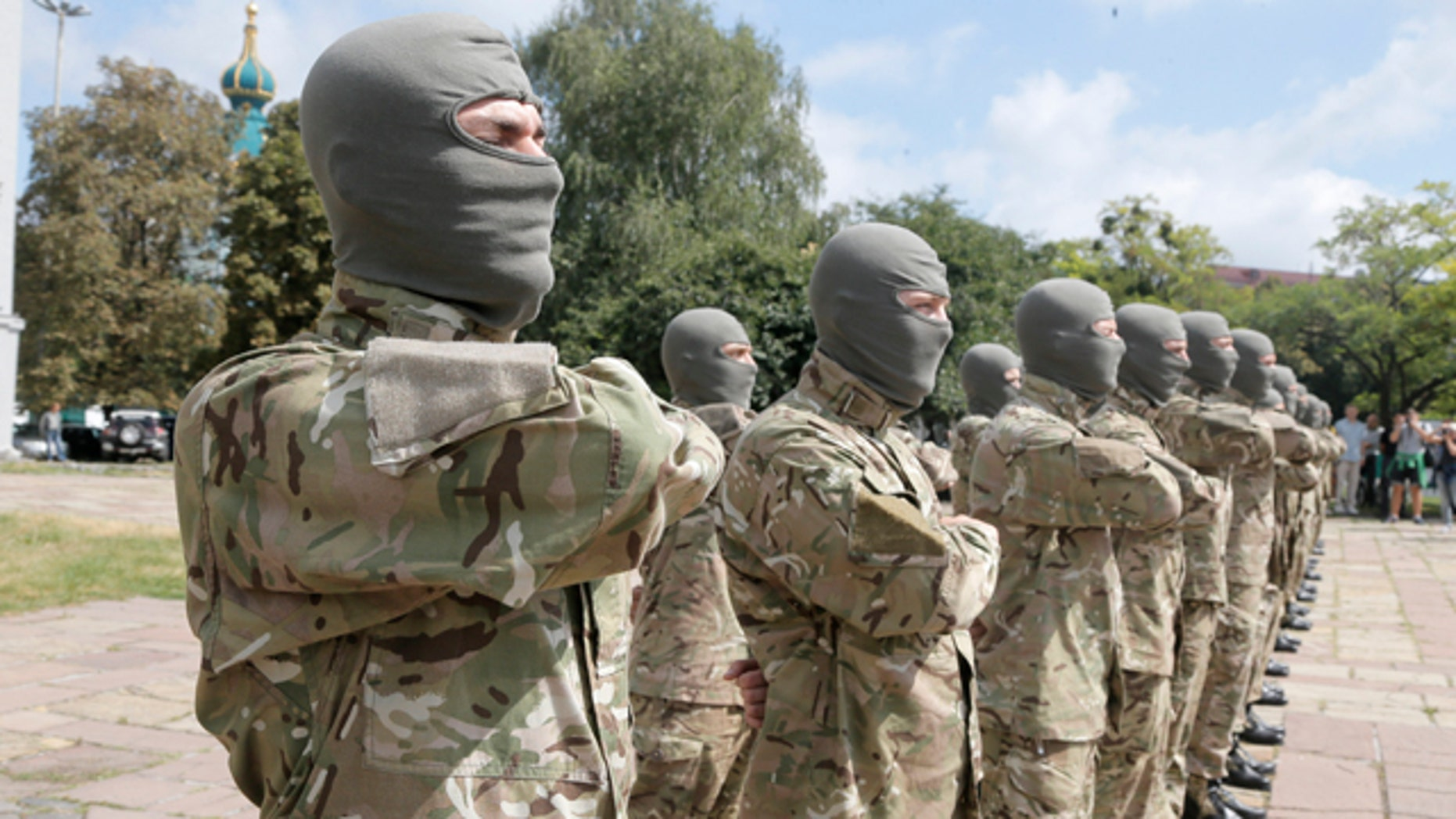 August 17, 2014: Volunteers take an oath of allegiance to Ukraine, before being sent to the eastern part of Ukraine to join the ranks of special battalion 'Azov' fighting against pro-Russian separatists. (AP Photo/Efrem Lukatsky)