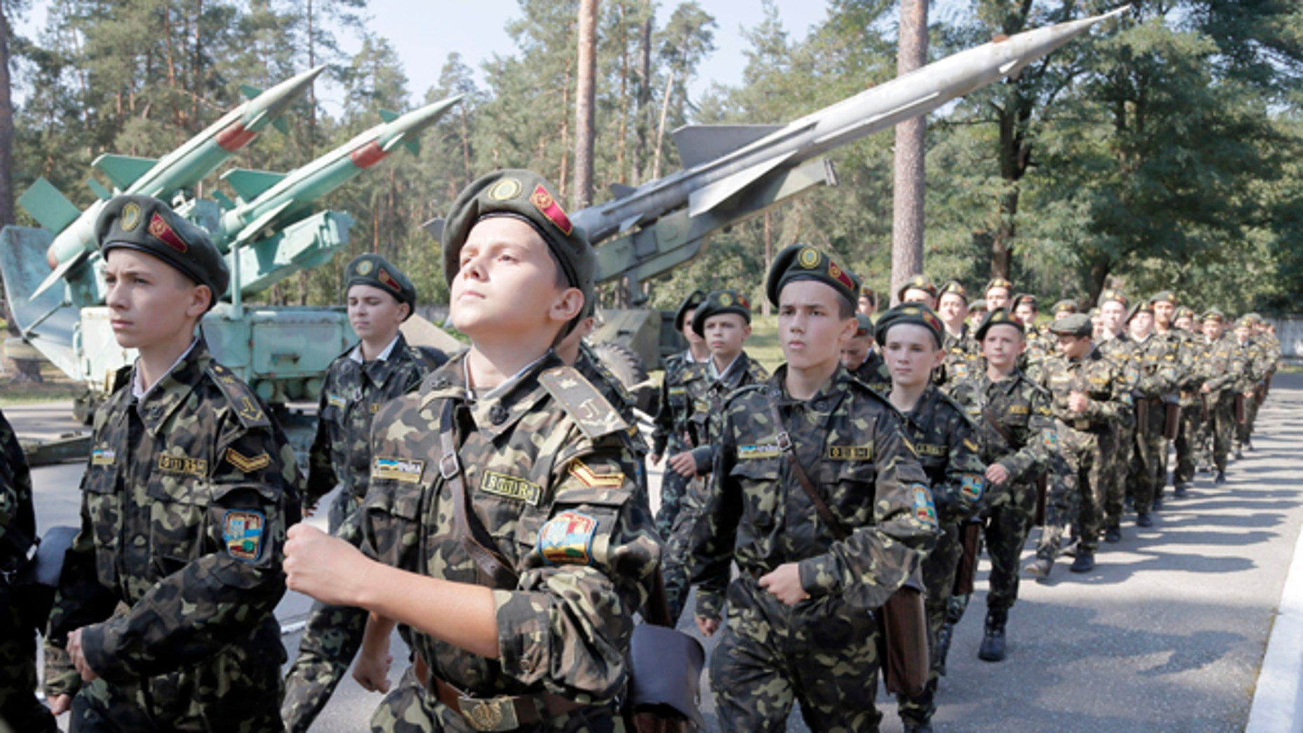 September 9, 2014: Students march during a military training exercise in a military school in Boyarka, near Kiev, Ukraine. (AP Photo/Efrem Lukatsky)