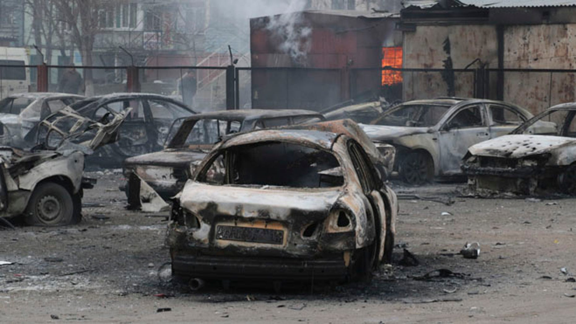 Jan. 24, 2015: Burned cars on a destroyed parking site in a residential area in Mariupol, Ukraine.
