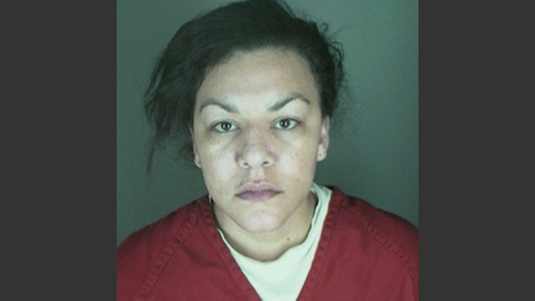 This undated booking photo provided by the Longmont Police Department shows Dynel Lane, 34, who is accused of stabbing a pregnant woman in the stomach and removing her baby, while the expectant mother visited her home to buy baby clothes advertised on Craigslist, authorities said. (AP Photo/ Longmont Police Department)