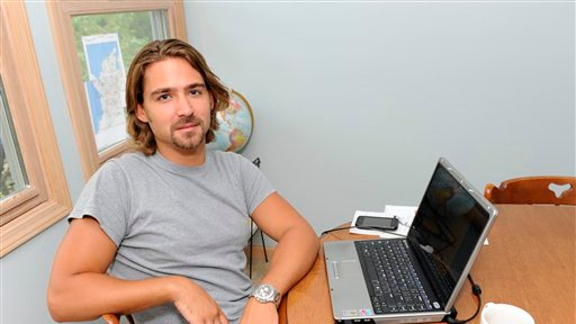 September 2: Ryan McGrath, 26, poses in his home in Michigan City, Ind. McGrath has been working part time designing web sites for small businesses but wants steadier full-time work.
