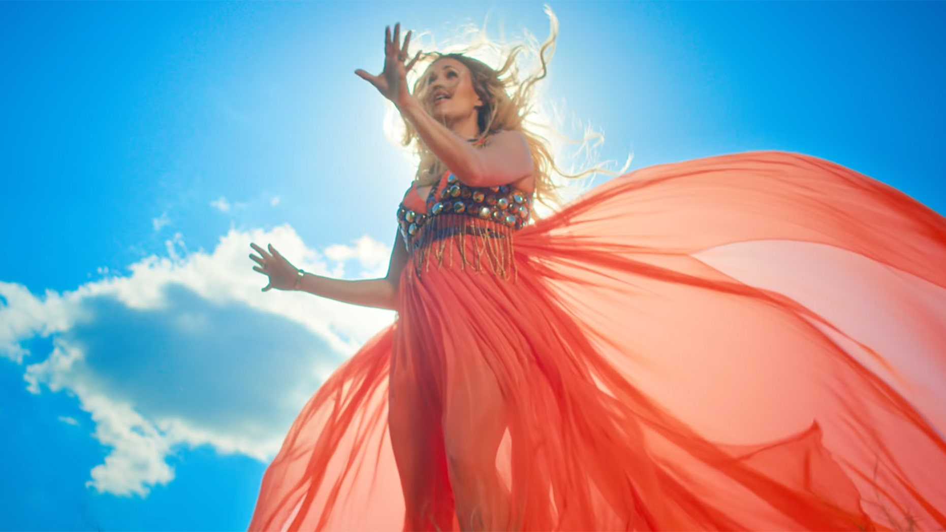 """Carrie Underwood gave fans a glimpse of her baby bump in her new music video for """"Love Wins."""""""