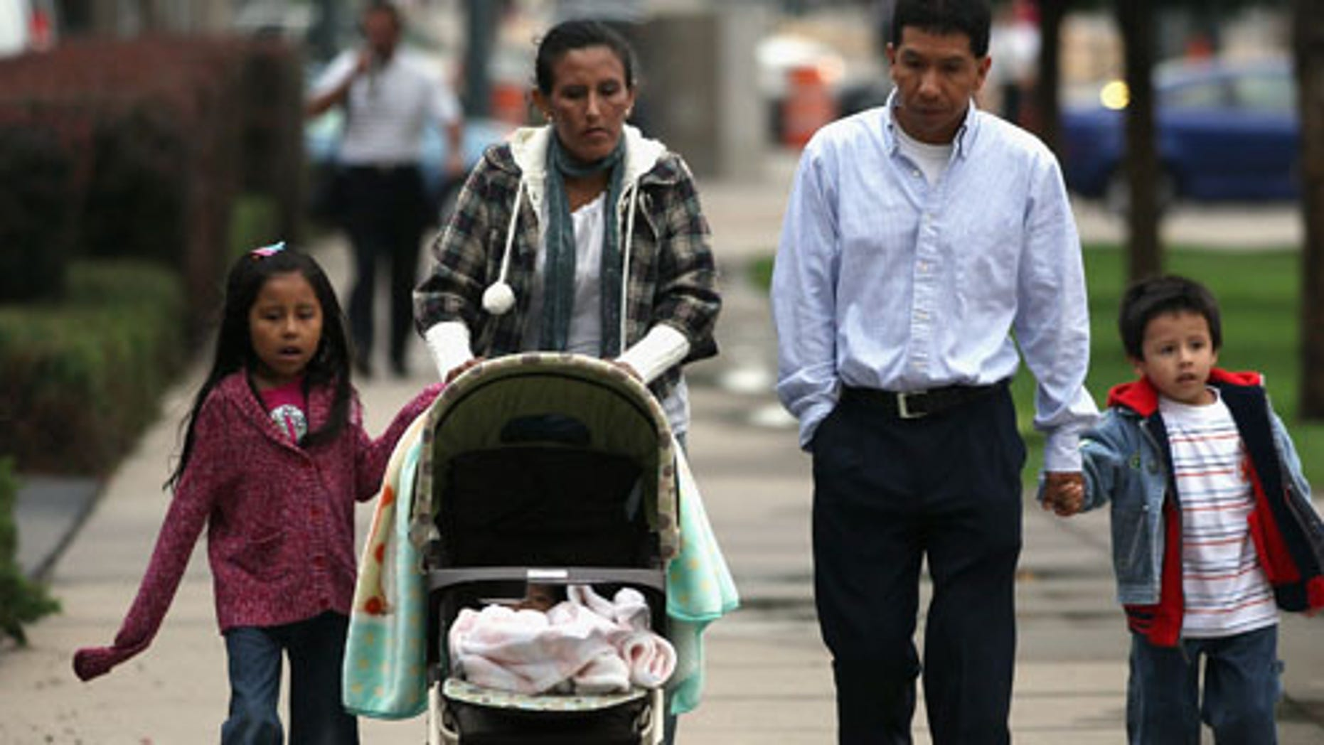 Undocumented Mexican immigrant Jeanette Vizguerra (L), her husband Salvador and their children Luna, 7, and Roberto, 5, walk to her immigration hearing in federal court on July 13, 2011 in Denver, Colorado.