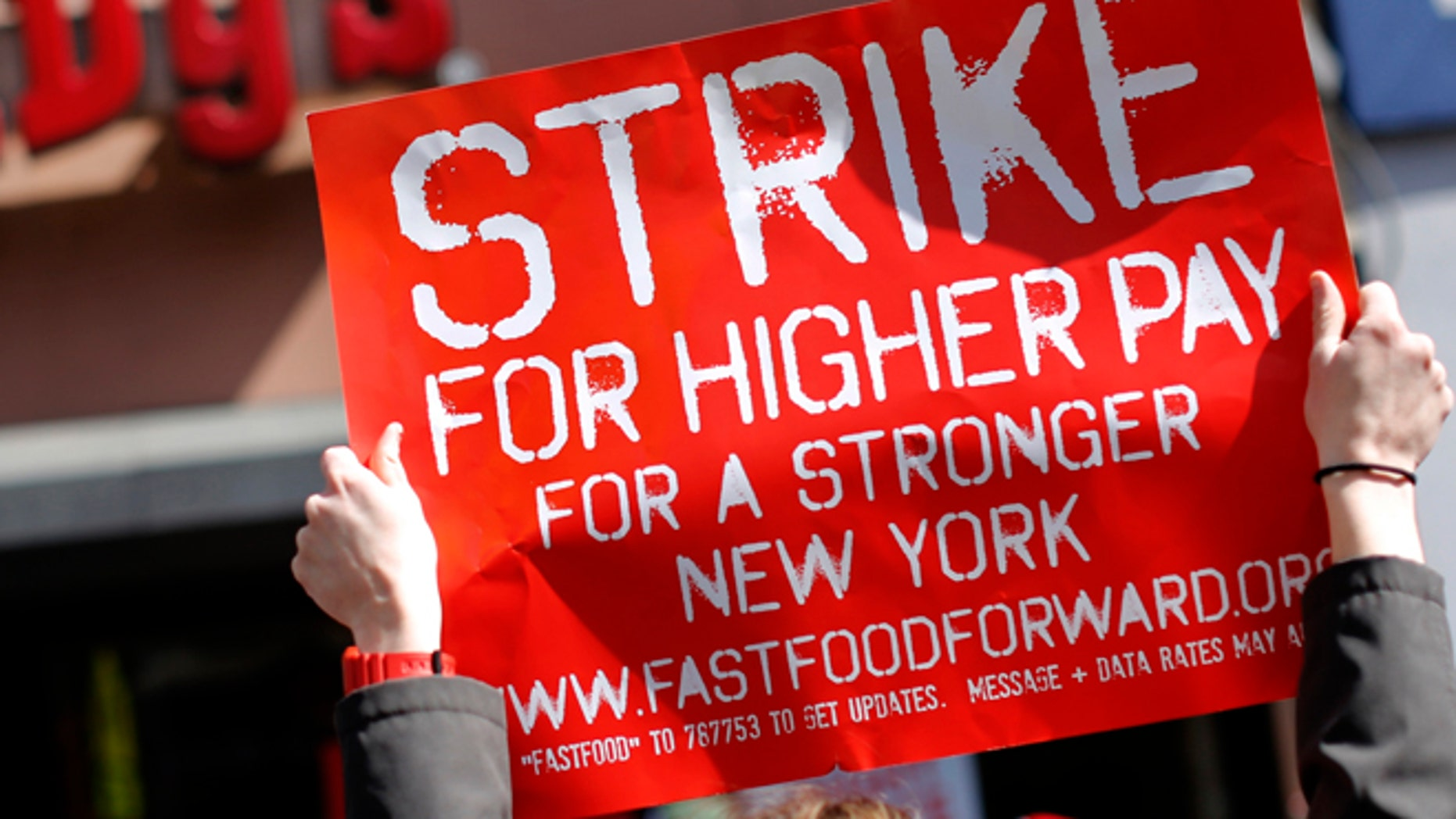 FILE: April 4, 2013: Demonstrators protesting low wages and the lack of union representation in the fast food industry outside in the Brooklyn Borough of New York.