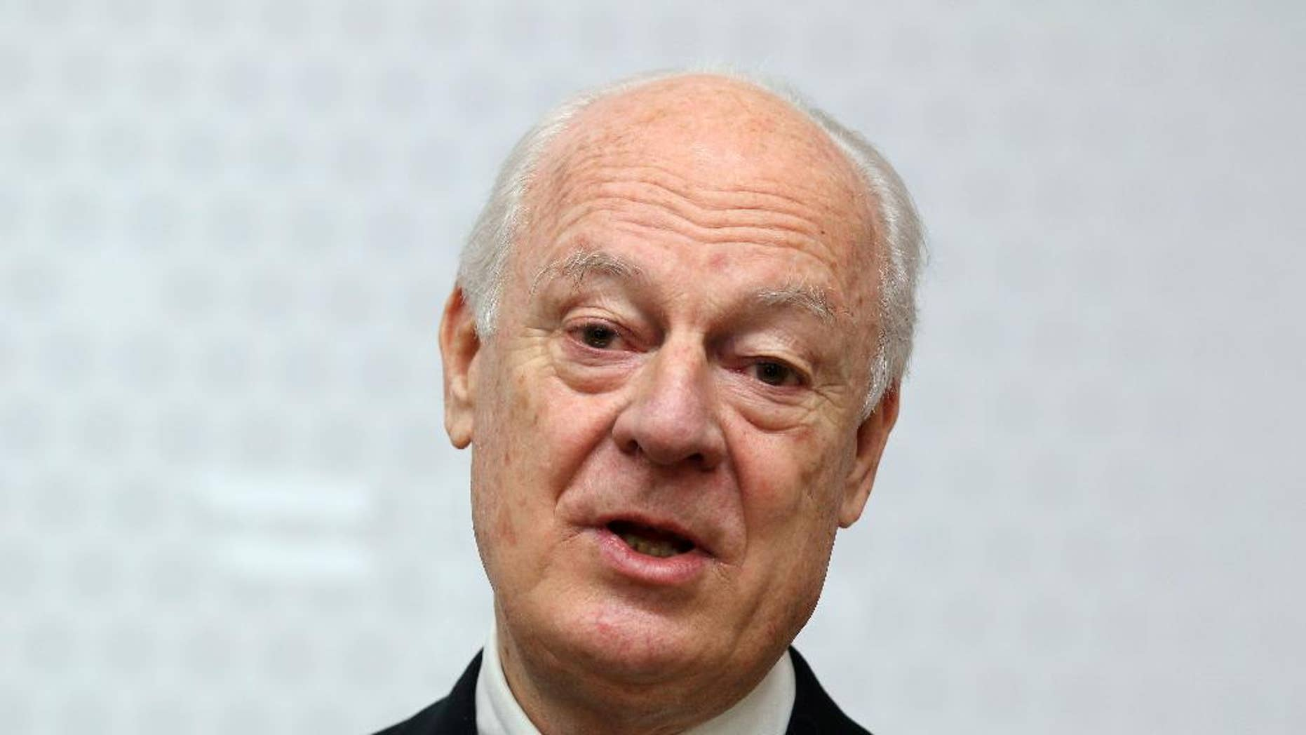 """FILE - In this Feb. 13, 2015, file photo, UN Special Envoy for Syria Staffan de Mistura informs the media after talks with Austrian Foreign Minister Sebastian Kurz at the foreign ministry in Vienna, Austria. The United Nations envoy to Syria said Tuesday, Feb. 17, he has received a commitment from the Syrian government to suspend airstrikes and artillery shelling on the city of Aleppo for six weeks to allow a proposed U.N. plan to """"freeze"""" hostilities in the country's largest city to be tested. (AP Photo/Ronald Zak, File)"""
